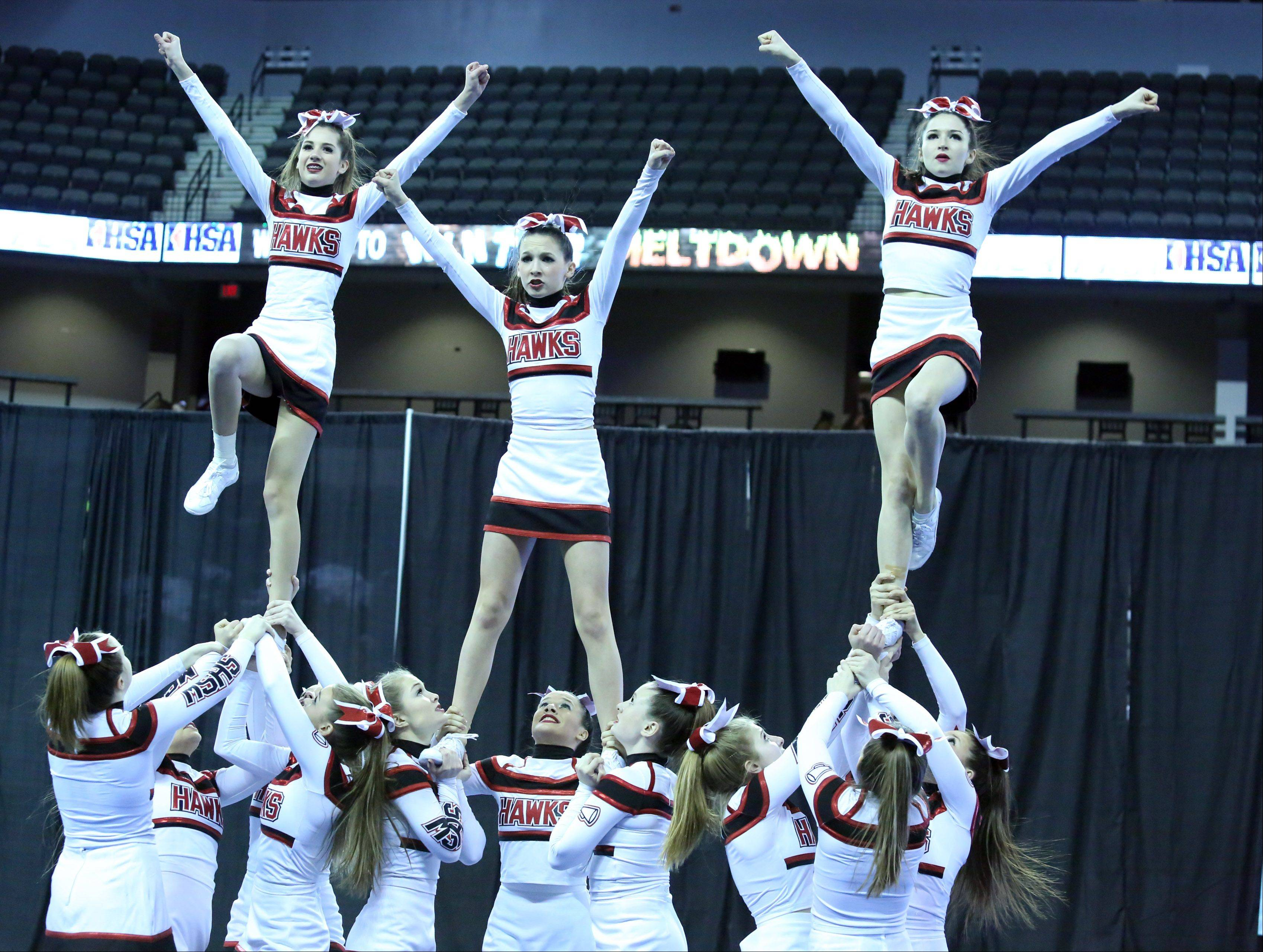 Maine South High School cheer team competes in the IHSA Winter Meltdown Cheerleading and Dance Competition at Sears Centre Arena on Saturday in Hoffman Estates.