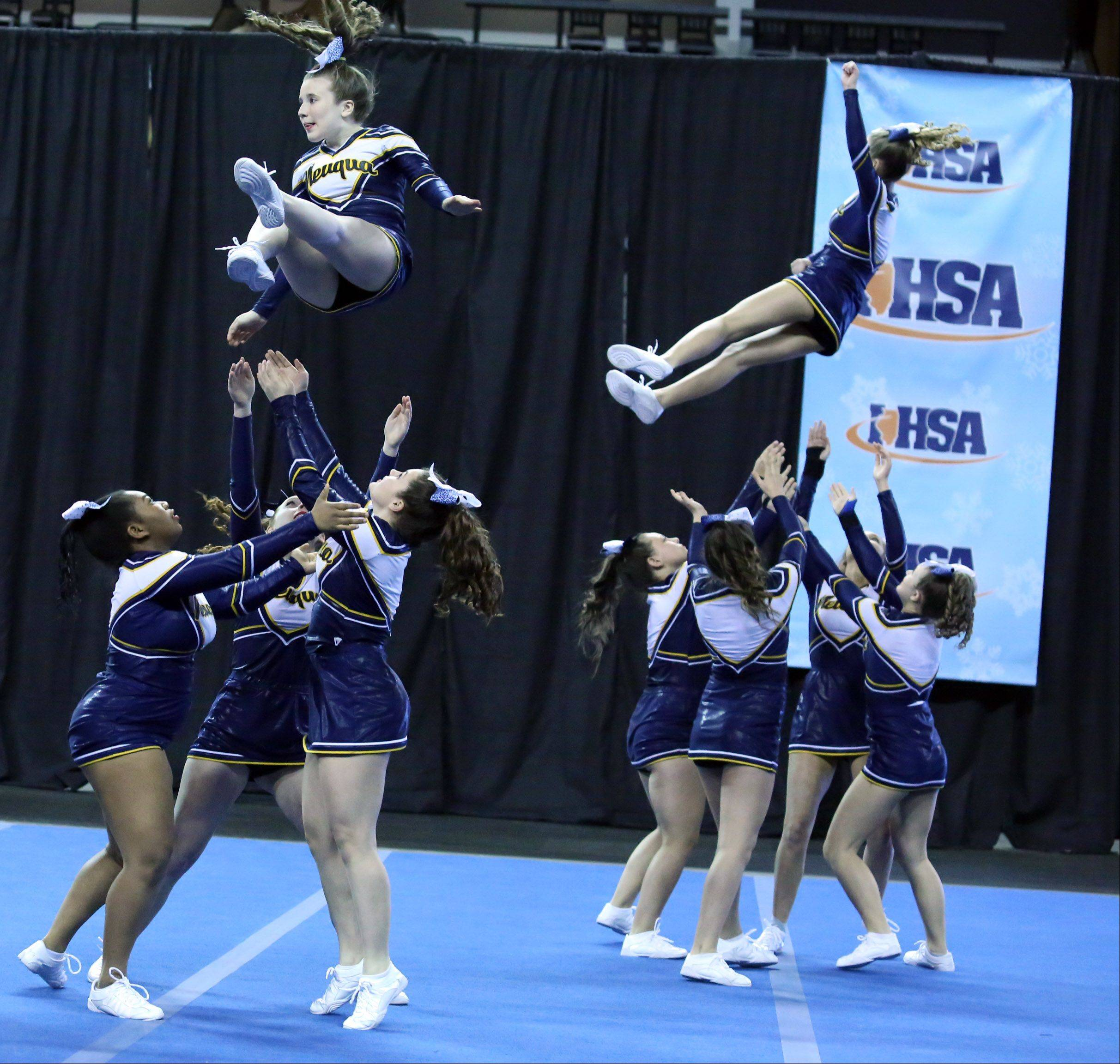 Neuqua Valley High School cheer team competes in the IHSA Winter Meltdown Cheerleading and Dance Competition at Sears Centre Arena on Saturday in Hoffman Estates.