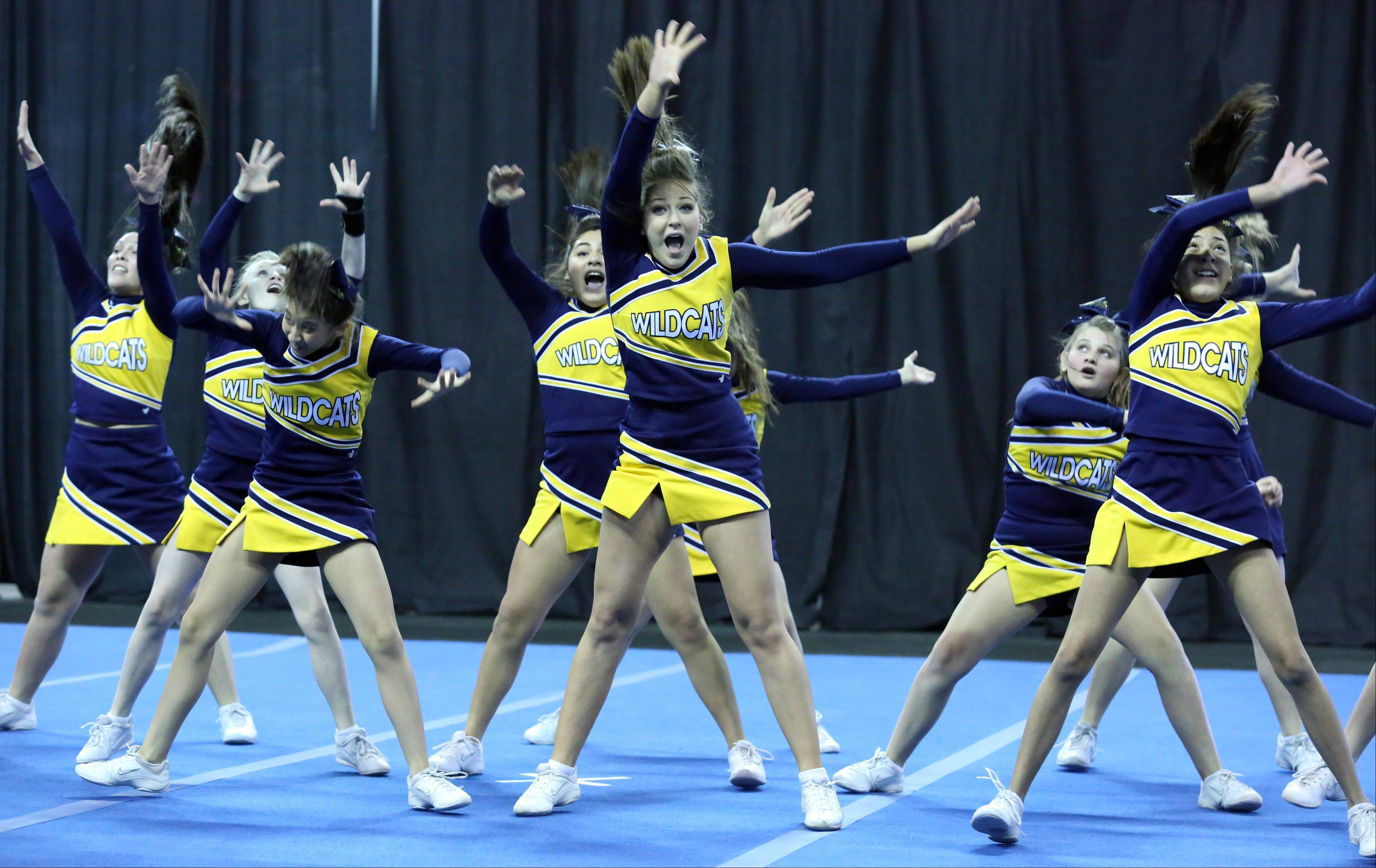 Round Lake Middle School cheer team competes in the IHSA Winter Meltdown Cheerleading and Dance Competition at Sears Centre Arena on Saturday in Hoffman Estates.