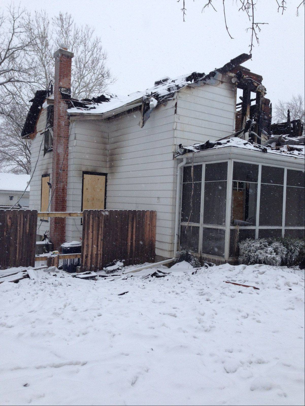 The family of five lived in this Carpentersville house on the 100 block of North Washington Street. They returned from vacation Thursday to find that a fire had destroyed it and everything inside. The family is temporarily living with relatives in Carpentersville.