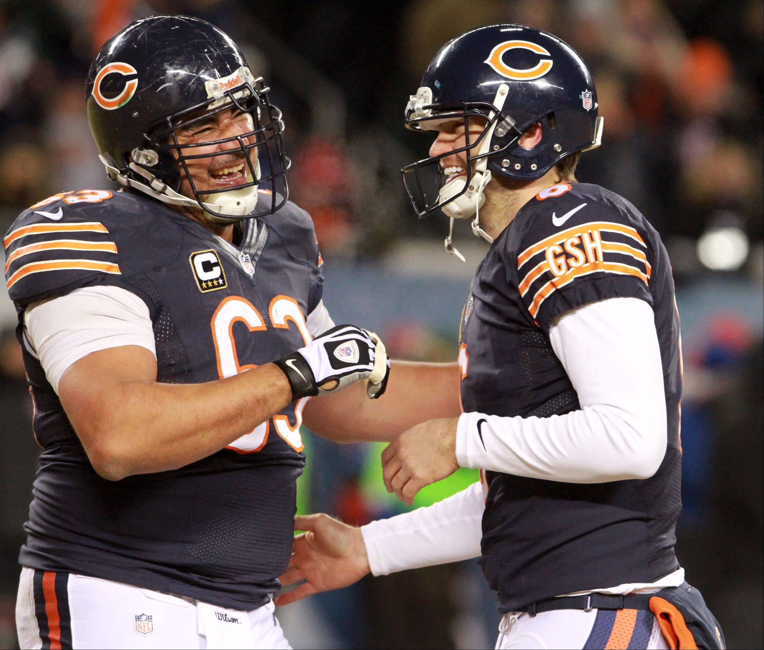 Bears quarterback Jay Cutler, at right with center Roberto Garza, did as more off the field than on to show that he was worth the big investment.