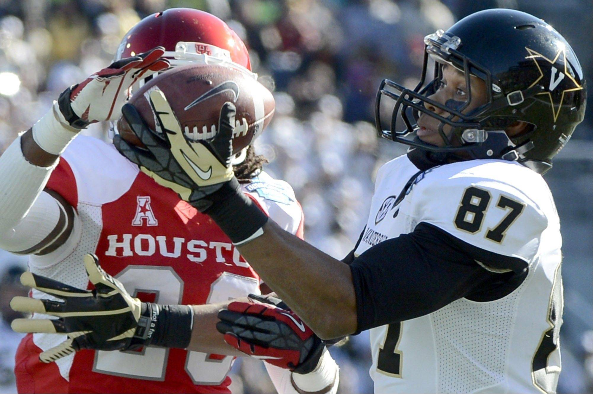 Vanderbilt wide receiver Jordan Matthews catches a second-quarter pass in front of Houston defensive back Trevon Stewart during the Compass Bowl Saturday in Alabama.