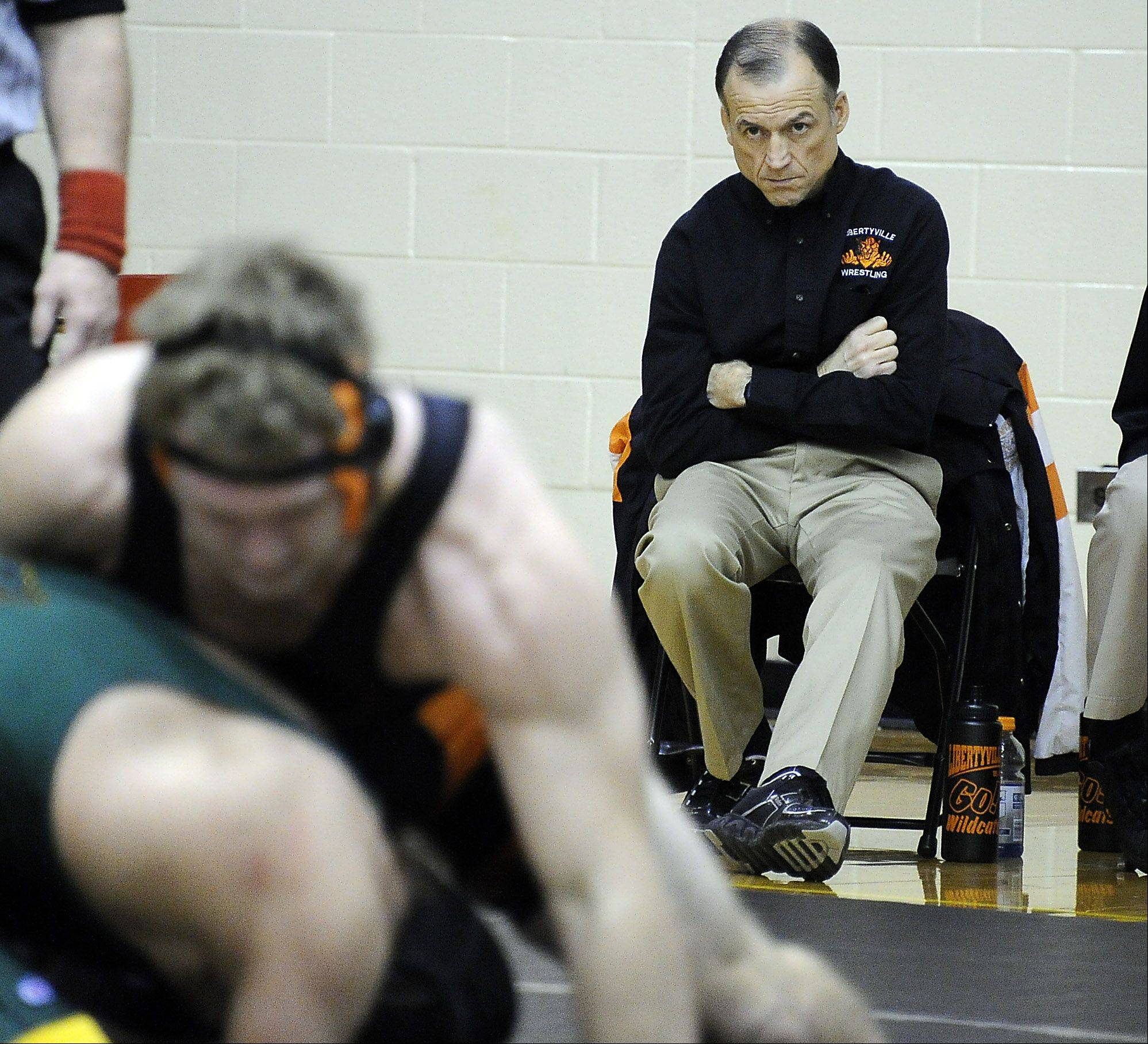 Libertyville wrestling coach Dale Eggert watches with purpose as his one of his wrestlers competes against Crystal Lake South in Saturday's quad at Schaumburg.