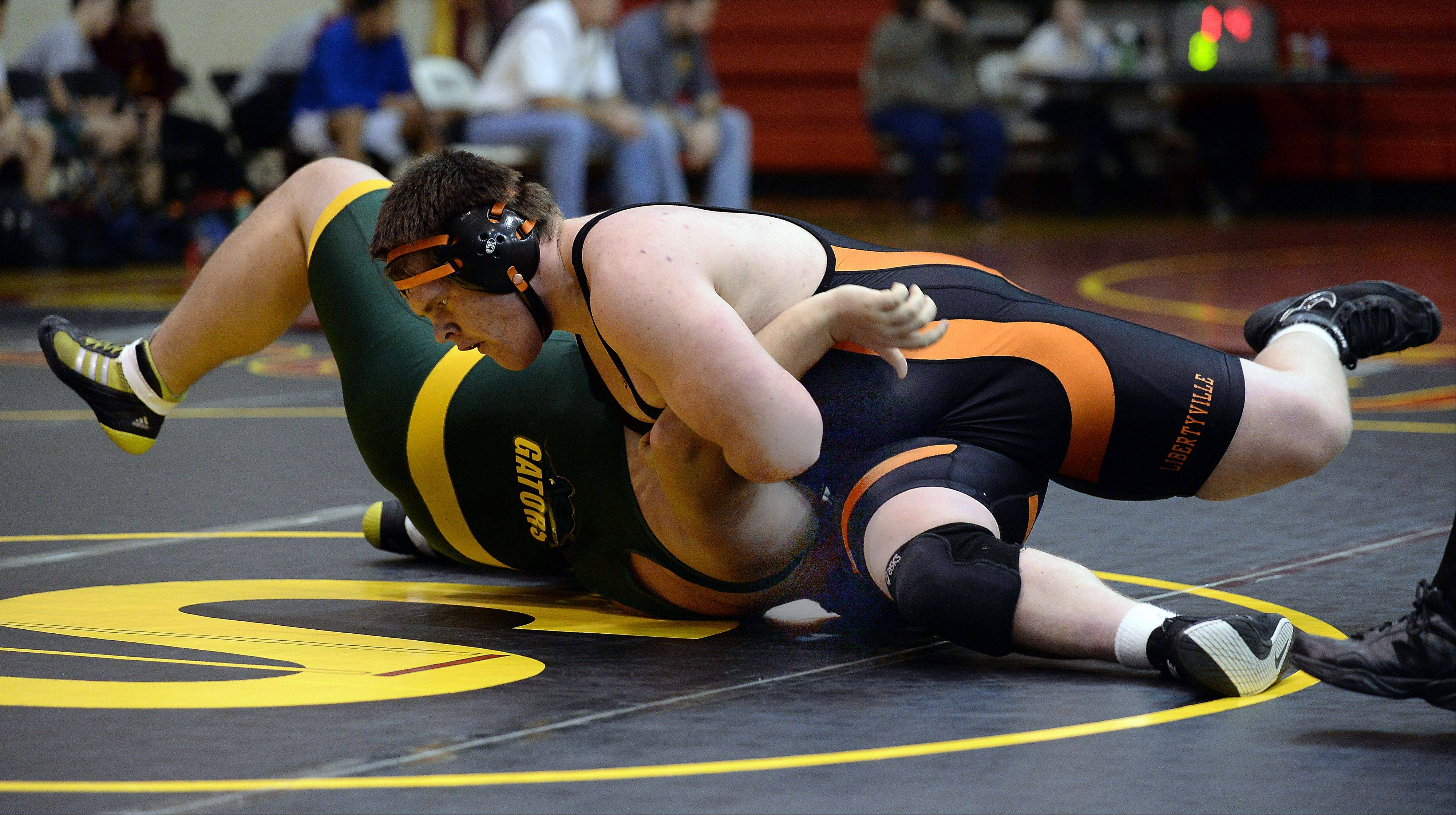 Libertyville's Chris McDermand handles Crystal Lake South's Bubby Gabric for the win at 285 pounds on Saturday at Schaumburg.