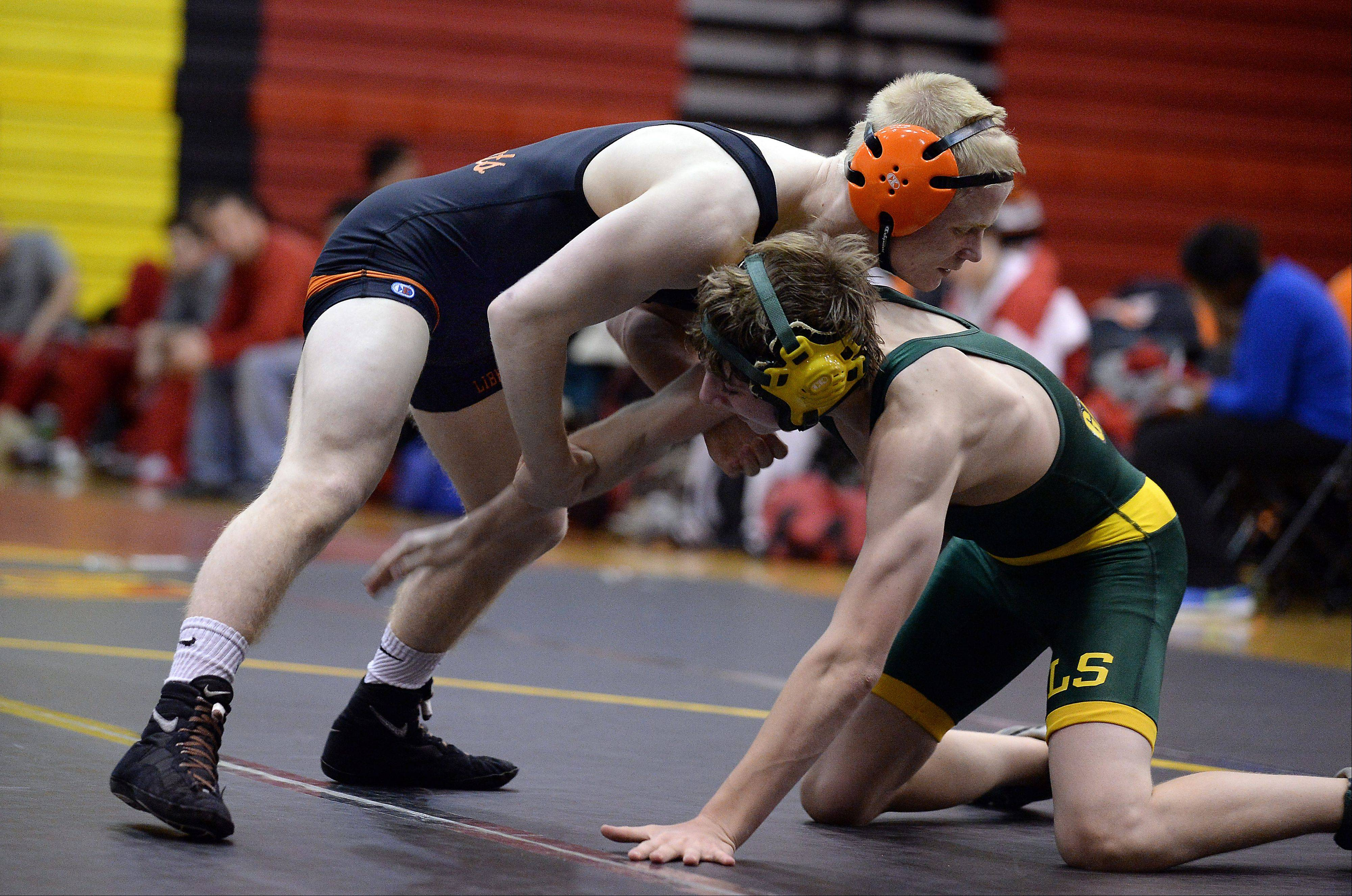 Libertyville's Steve Polakowski, top, handles Crystal Lake South's Joe Fetherling for a win at 126 pounds on Saturday at Schaumburg.