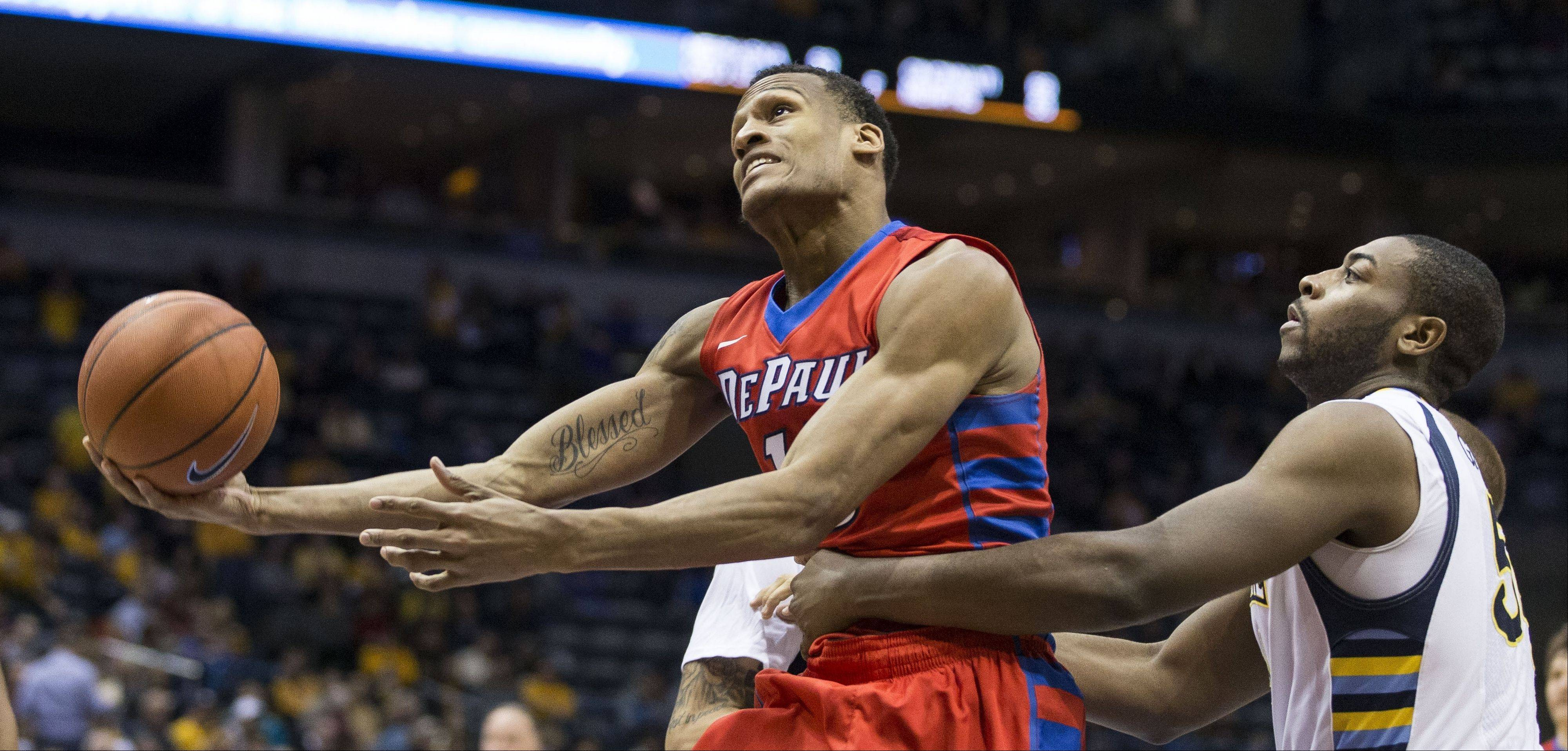 Marquette's Davante Gardner, right, fouls DePaul's Cleveland Melvin as he shoots during the second half of an NCAA college basketball game Saturday, Jan. 4, 2014, in Milwaukee.