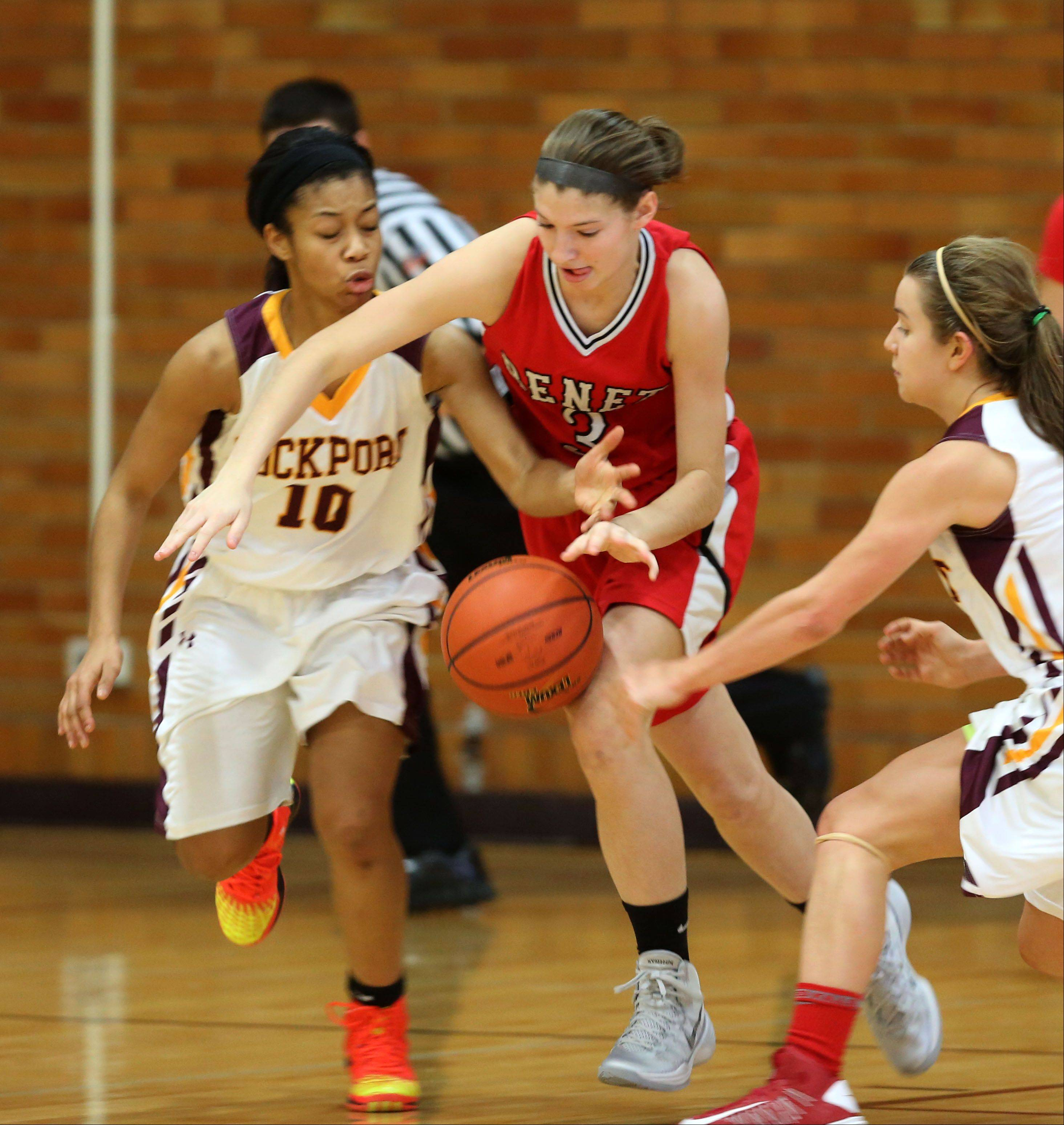 Benet's Emma Hlavin, center, moves up court past Lockport's Naomi Mayes, left, during girls basketball action.