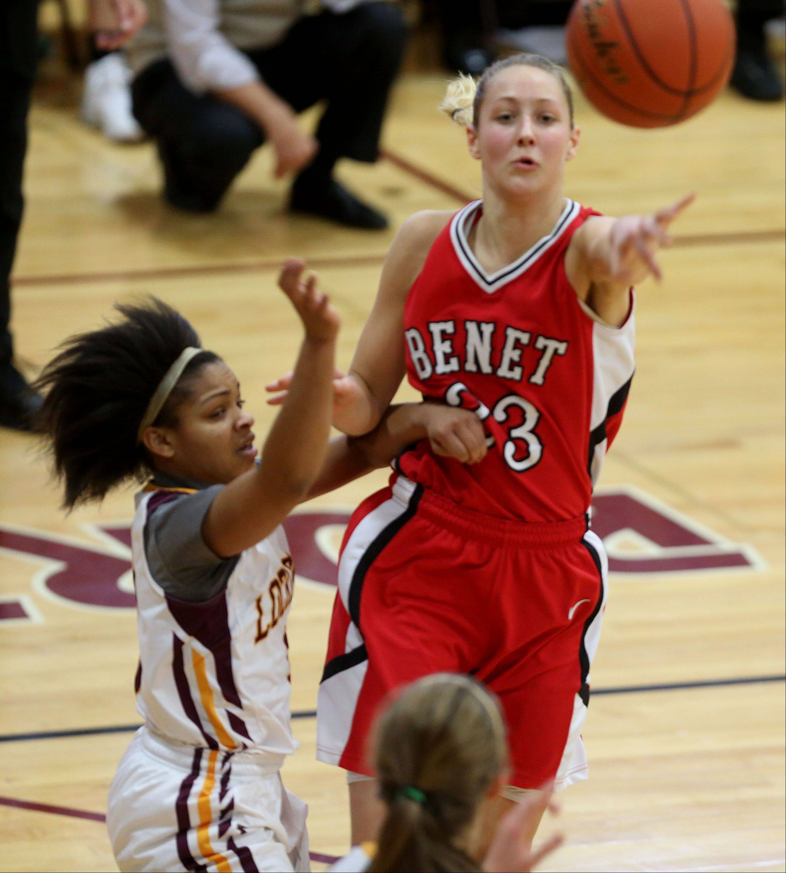 Benet's Emily Eshoo works against the Lockport defense during girls basketball action.
