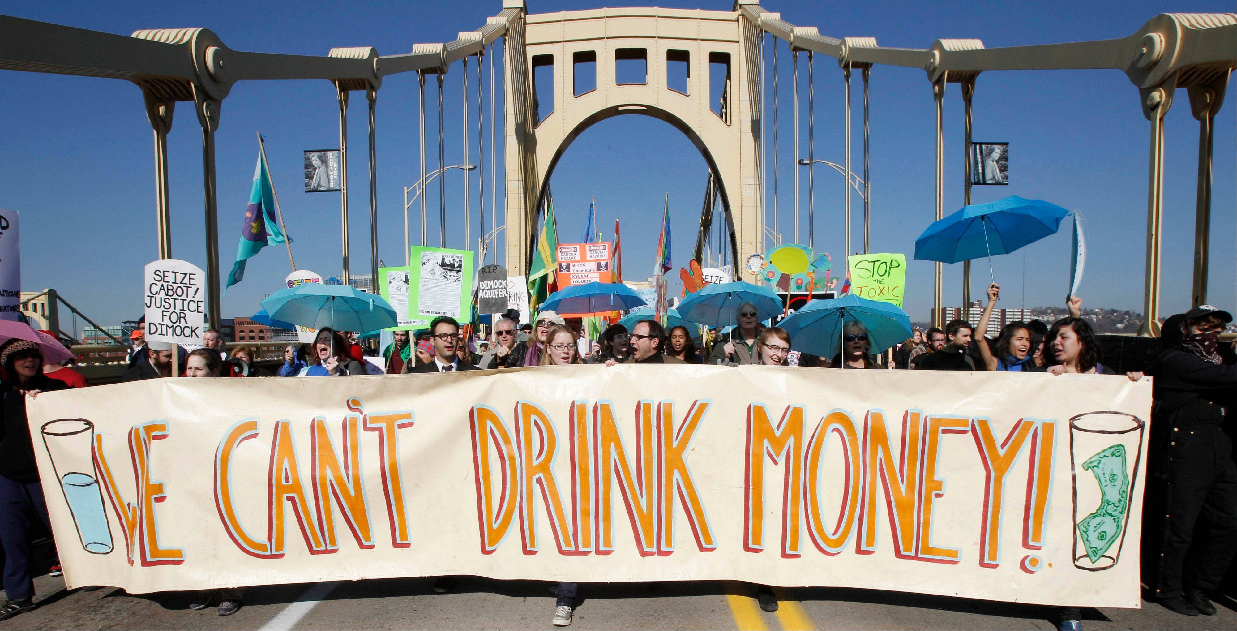 Marchers concerned with water pollution protest against hydraulic fracturing and gas well drilling in Pittsburgh in this file photo from Nov. 3, 2010.