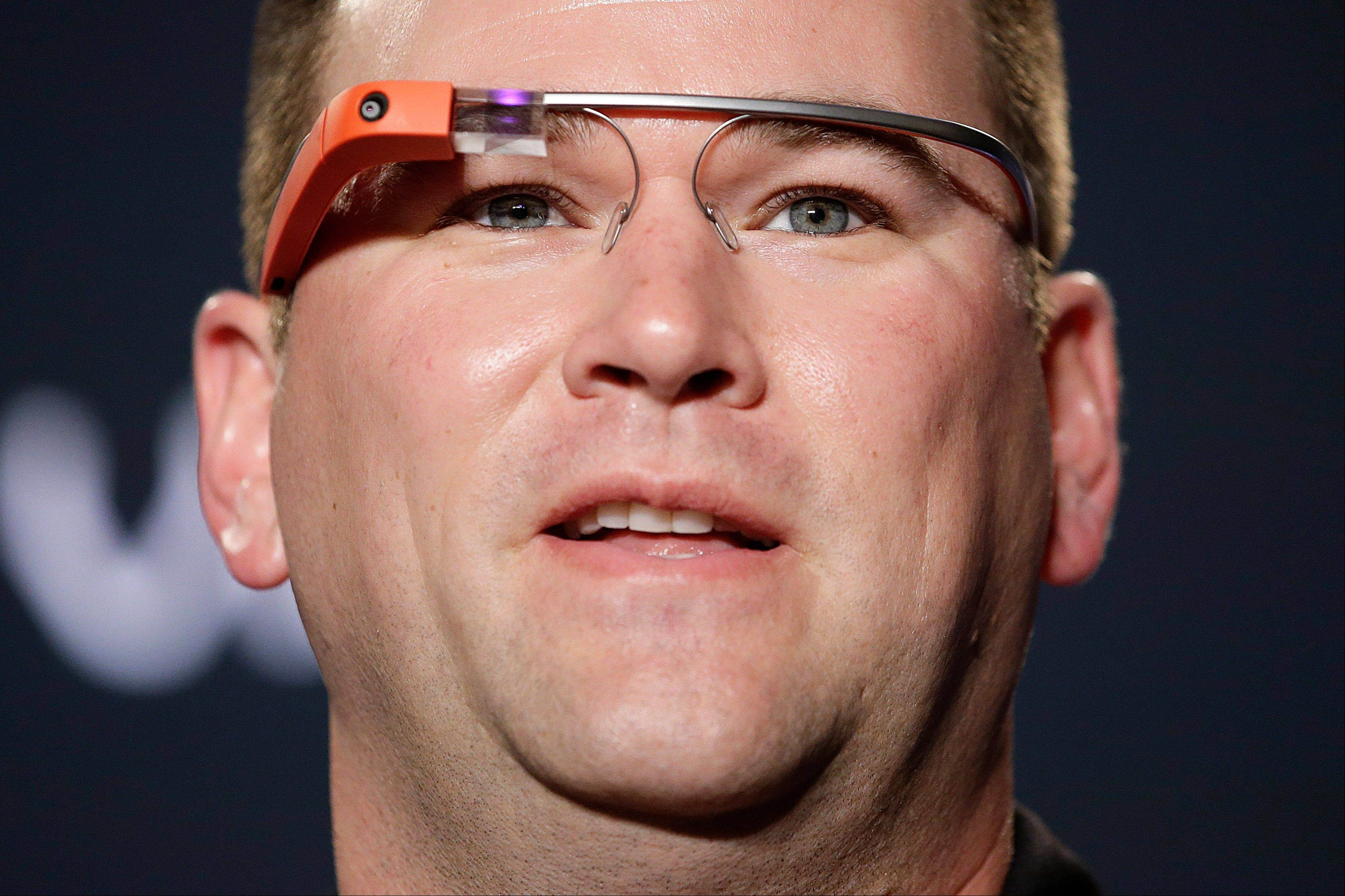 Stanford University football team's offensive coordinator Mike Bloomgren, wearing Google Glass, answers questions from the media during a news conference in Los Angeles.