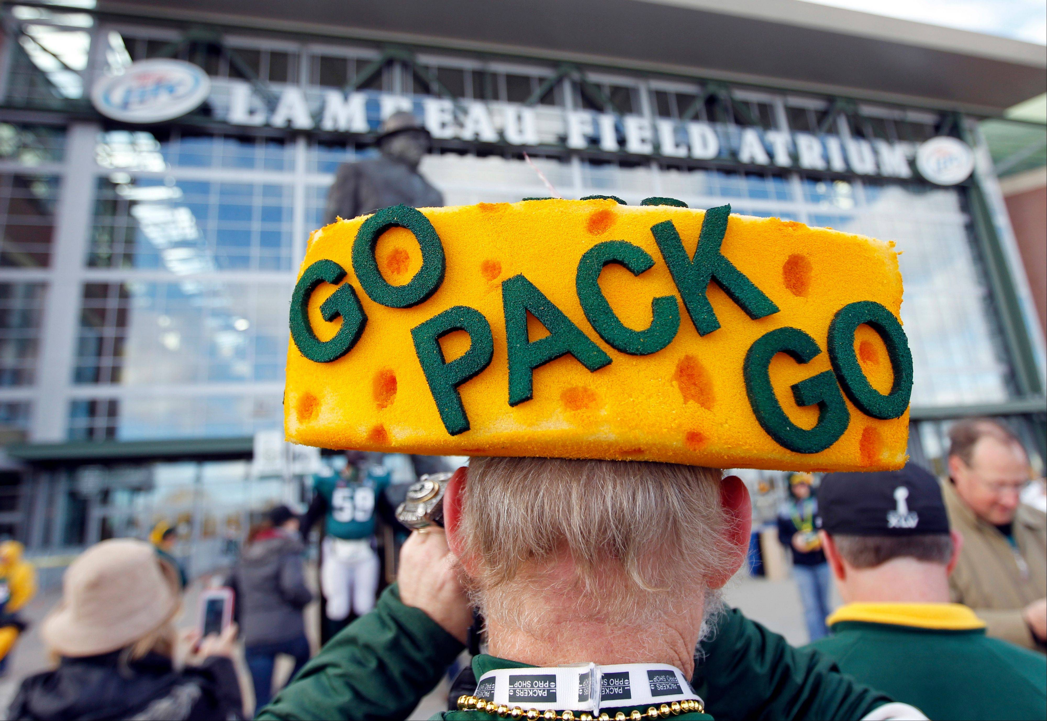 A fan takes pictures outside Lambeau Field before a game between the Green Bay Packers and the Philadelphia Eagles in Green Bay, Wis. The Packers may only play here about a dozen times a season, but fans can visit practically every day of the year, for a tour that costs just $11.