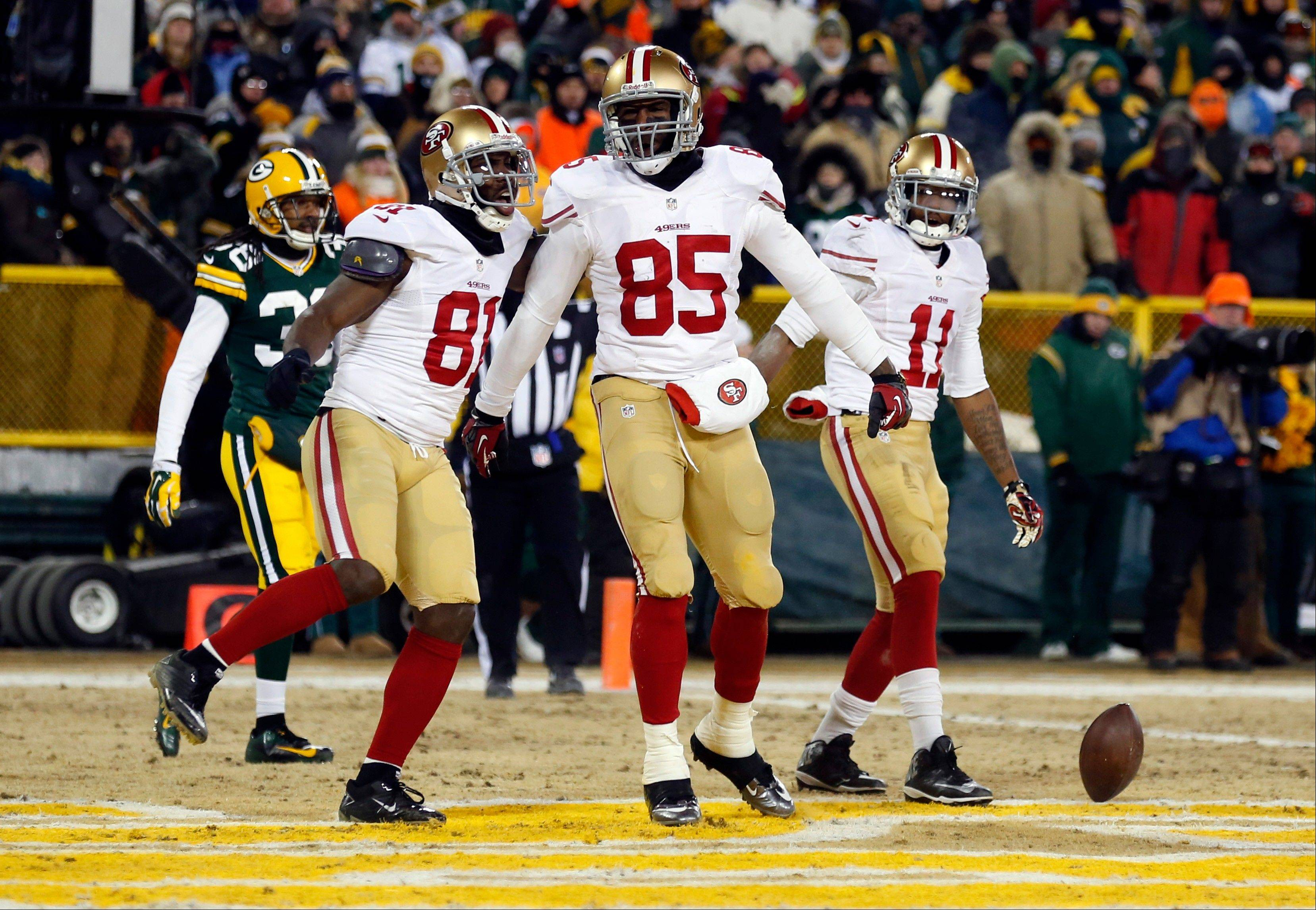 San Francisco 49ers tight end Vernon Davis (85) celebrates a touchdown catch with wide receiver Anquan Boldin (81) during the second half of an NFL wild-card playoff football game, Sunday, Jan. 5, 2014, in Green Bay, Wis.