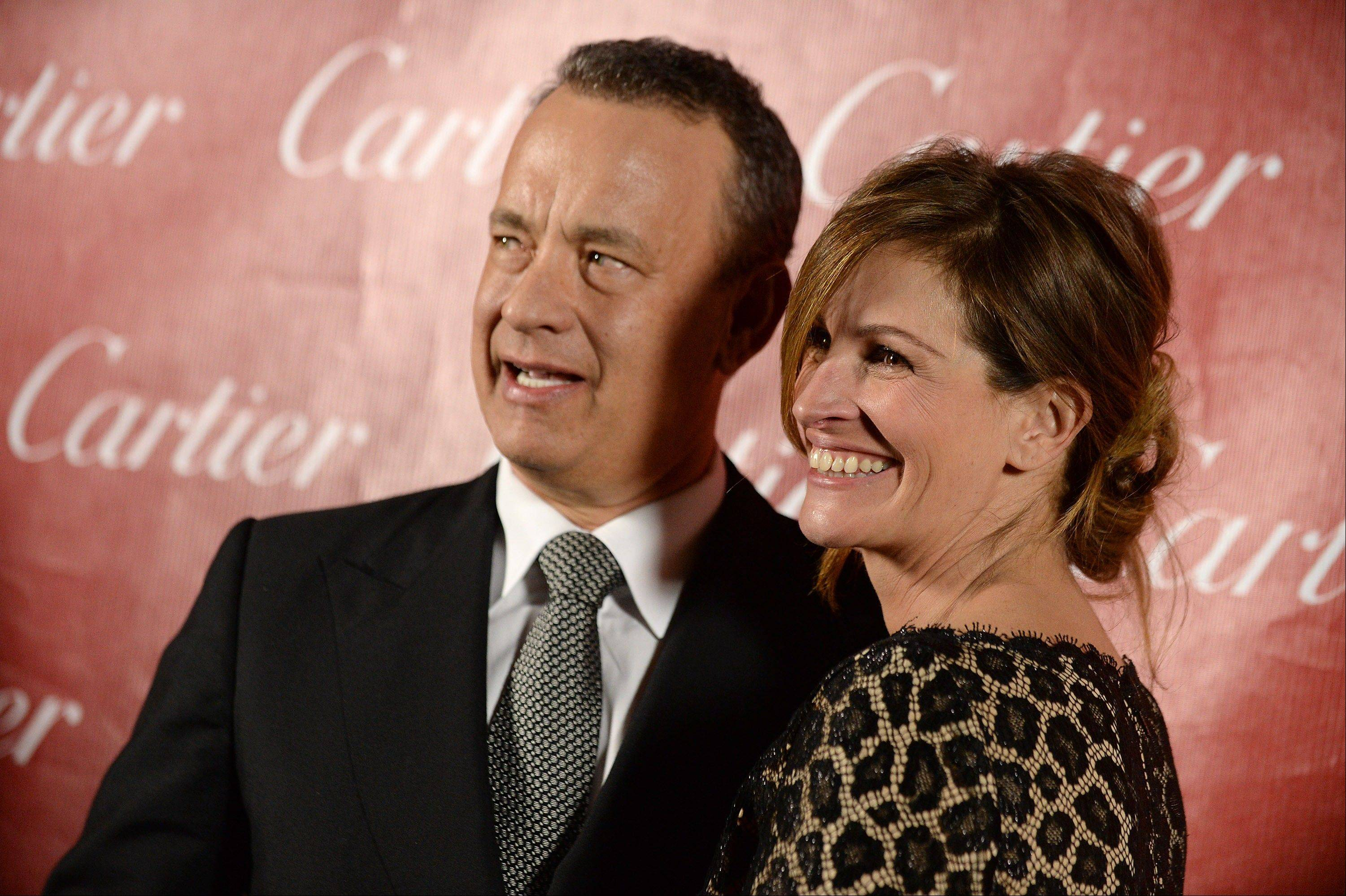 Tom Hanks and Julia Roberts pose backstage at the Palm Springs International Film Festival Awards Gala at the Palm Springs Convention Center on Saturday in Palm Springs, Calif.