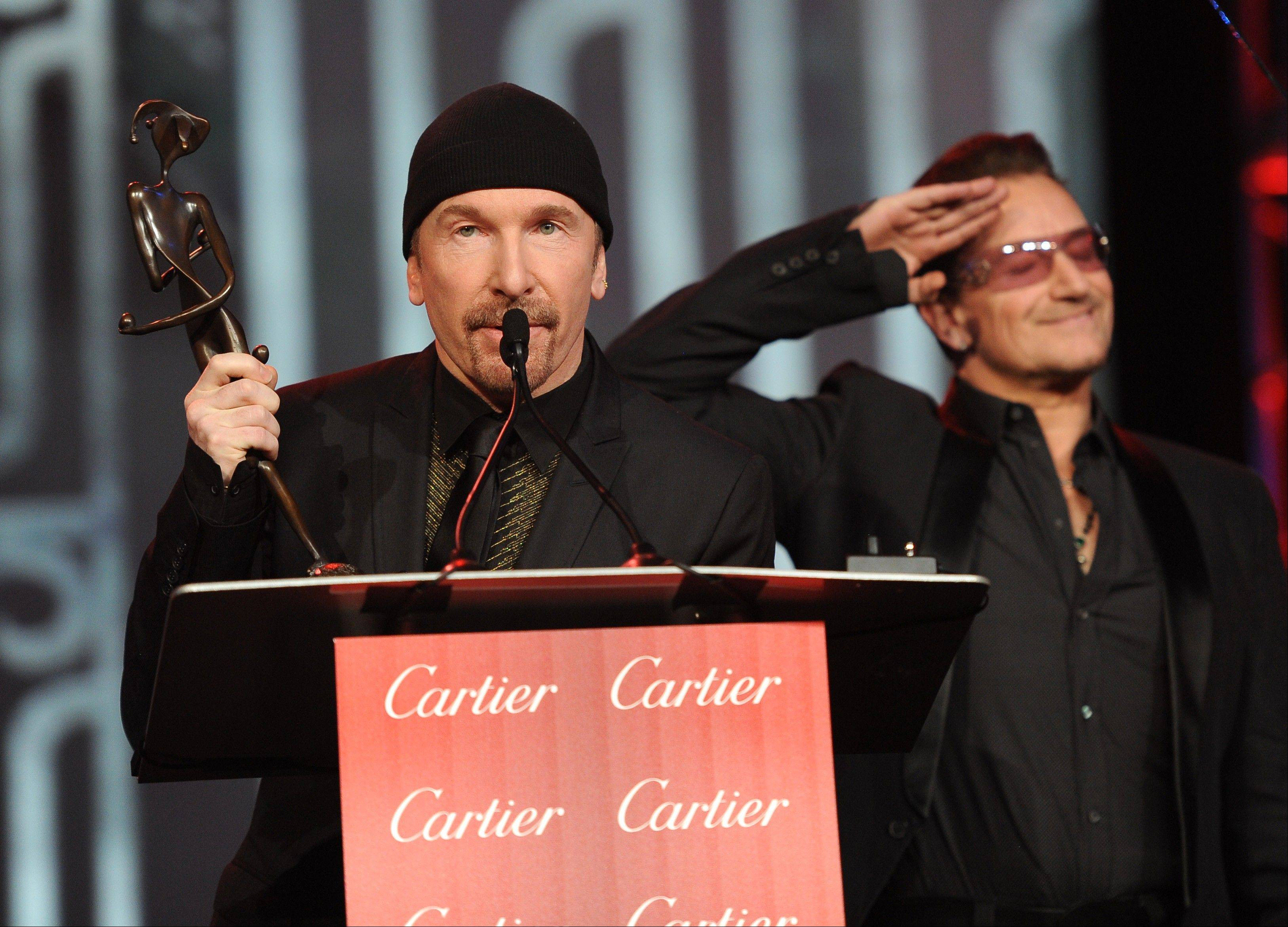 Bono, right, and The Edge, of musical group U2, accept the Sonny Bono Visionary Award at the Palm Springs International Film Festival Awards Gala at the Palm Springs Convention Center on Saturday in Palm Springs, Calif.