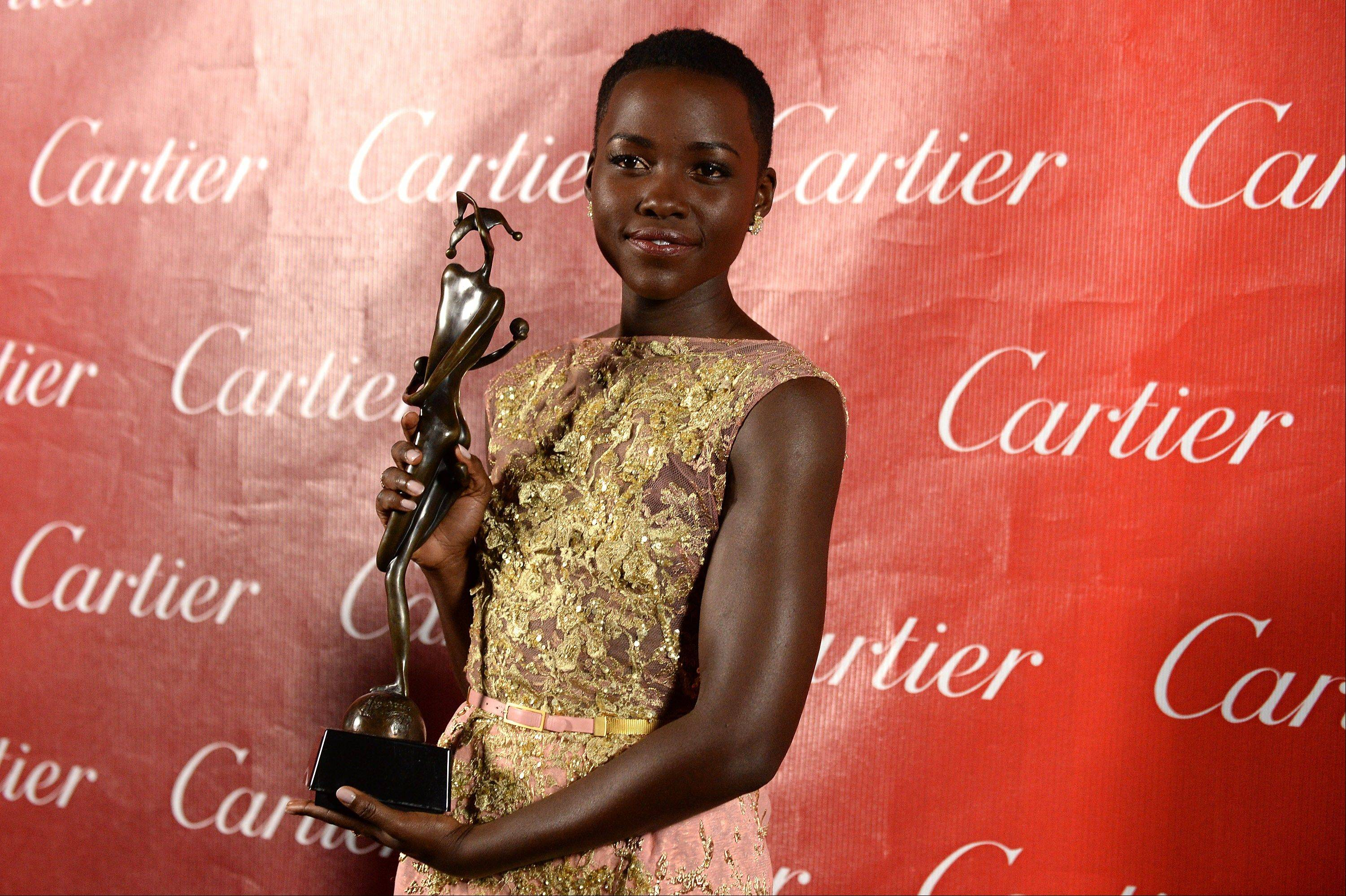 Lupita Nyong'o poses backstage at the Palm Springs International Film Festival Awards Gala at the Palm Springs Convention Center on Saturday in Palm Springs, Calif.