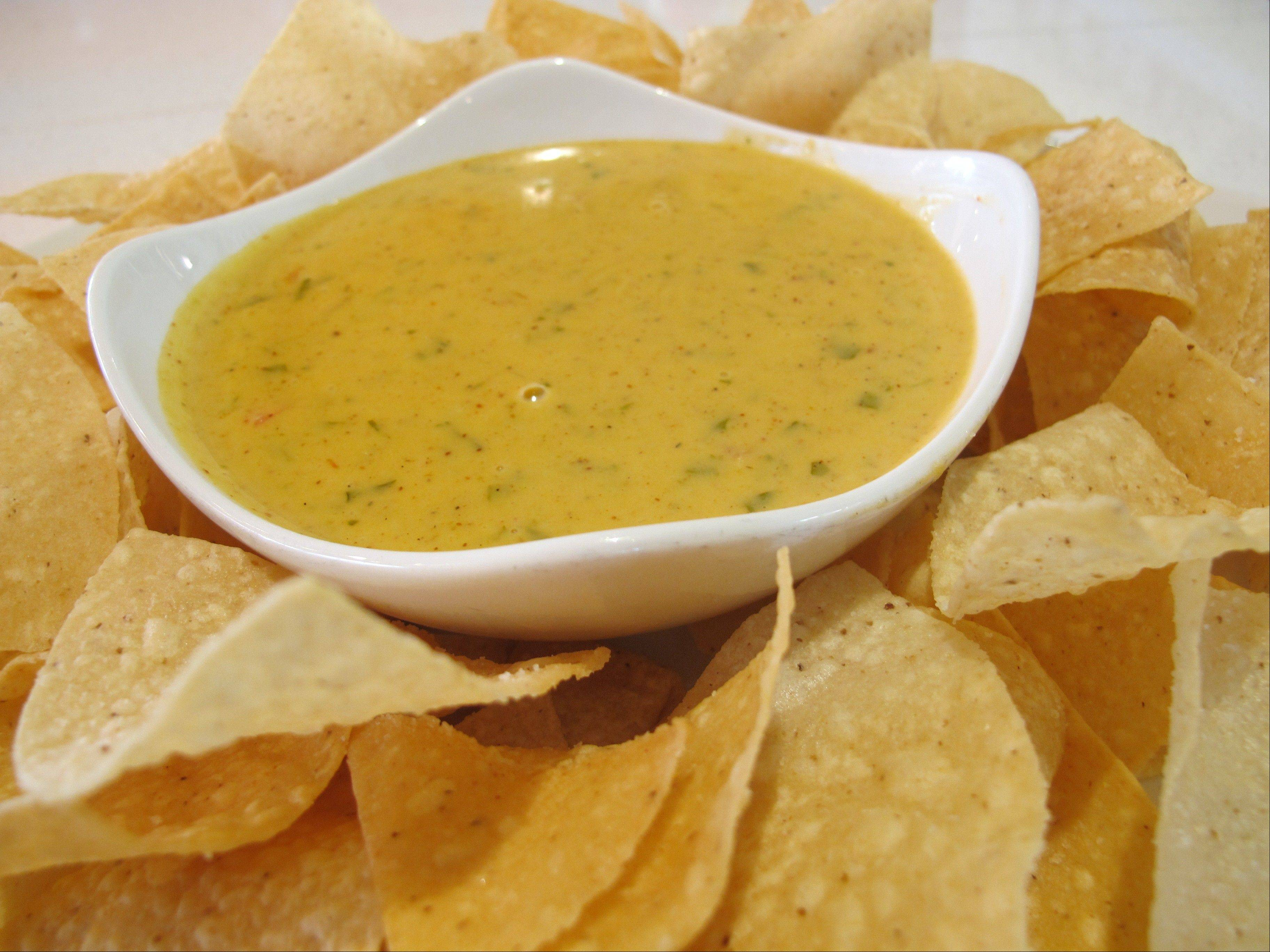 Cheese dip is served with tortilla chips at Big Orange in Little Rock, Ark. Big Orange is known for gourmet burgers, quality draft beer and tempura asparagus, but their creamy cheese dip is a crowd-pleaser.