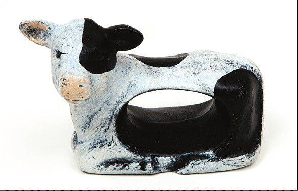 Handmade napkin rings, like this carved cow, are a unique addition to any collection.
