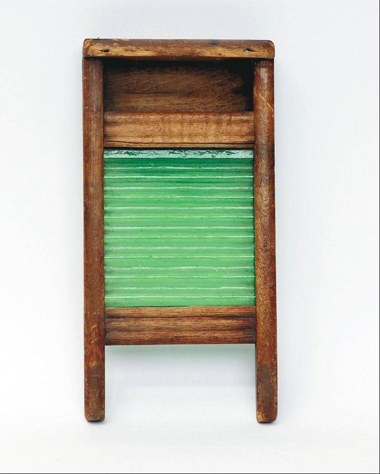 The most unusual of vintage washingboards in Frank and Yvonne Lisa's collection is this rare yellowware example, which cost $500 several years ago.