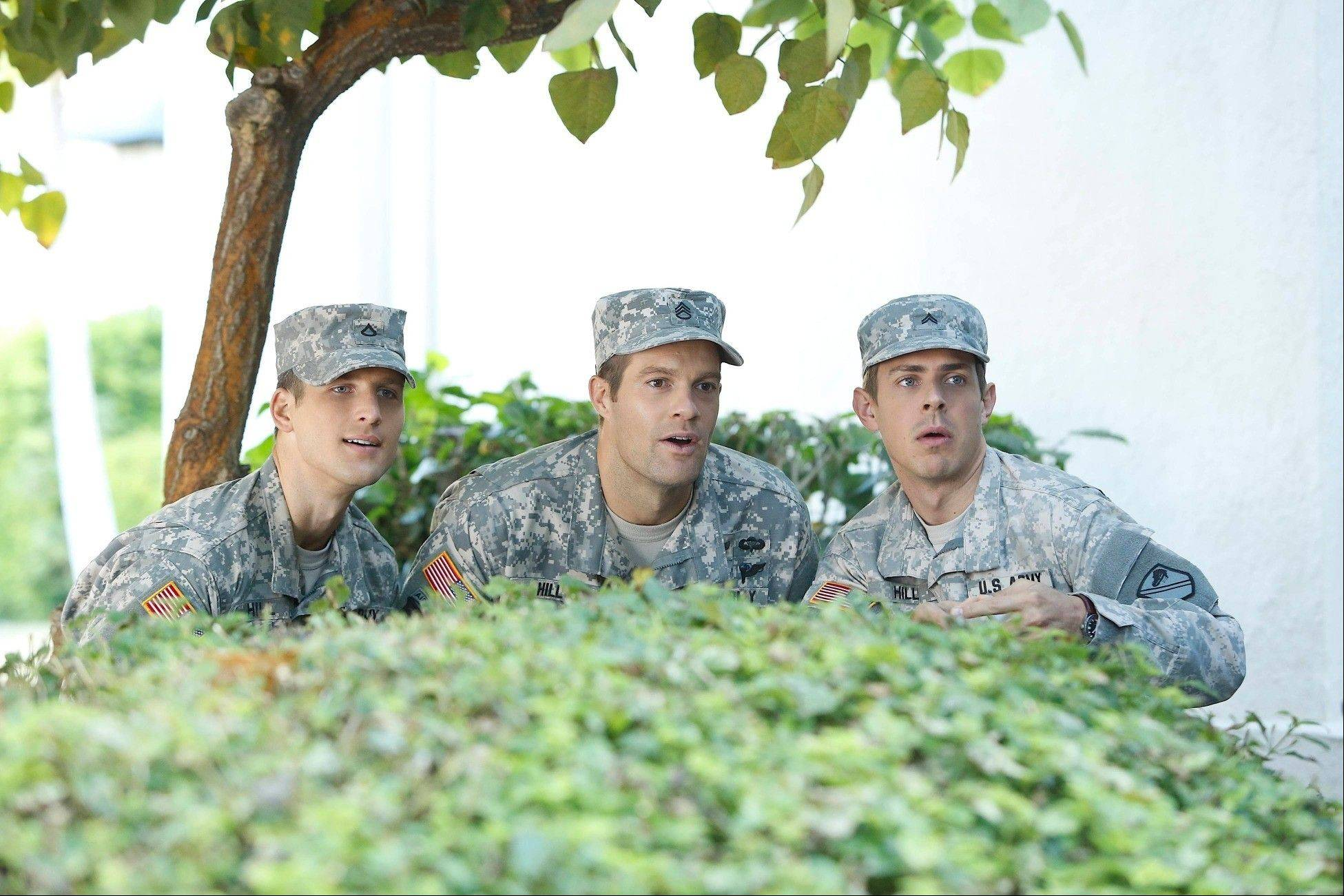 "Randy (Parker Young, left), Pete (Geoff Stults) and Derrick (Chris Lowell) watch the result of one of their pranks in new Fox sitcom ""Enlisted."""