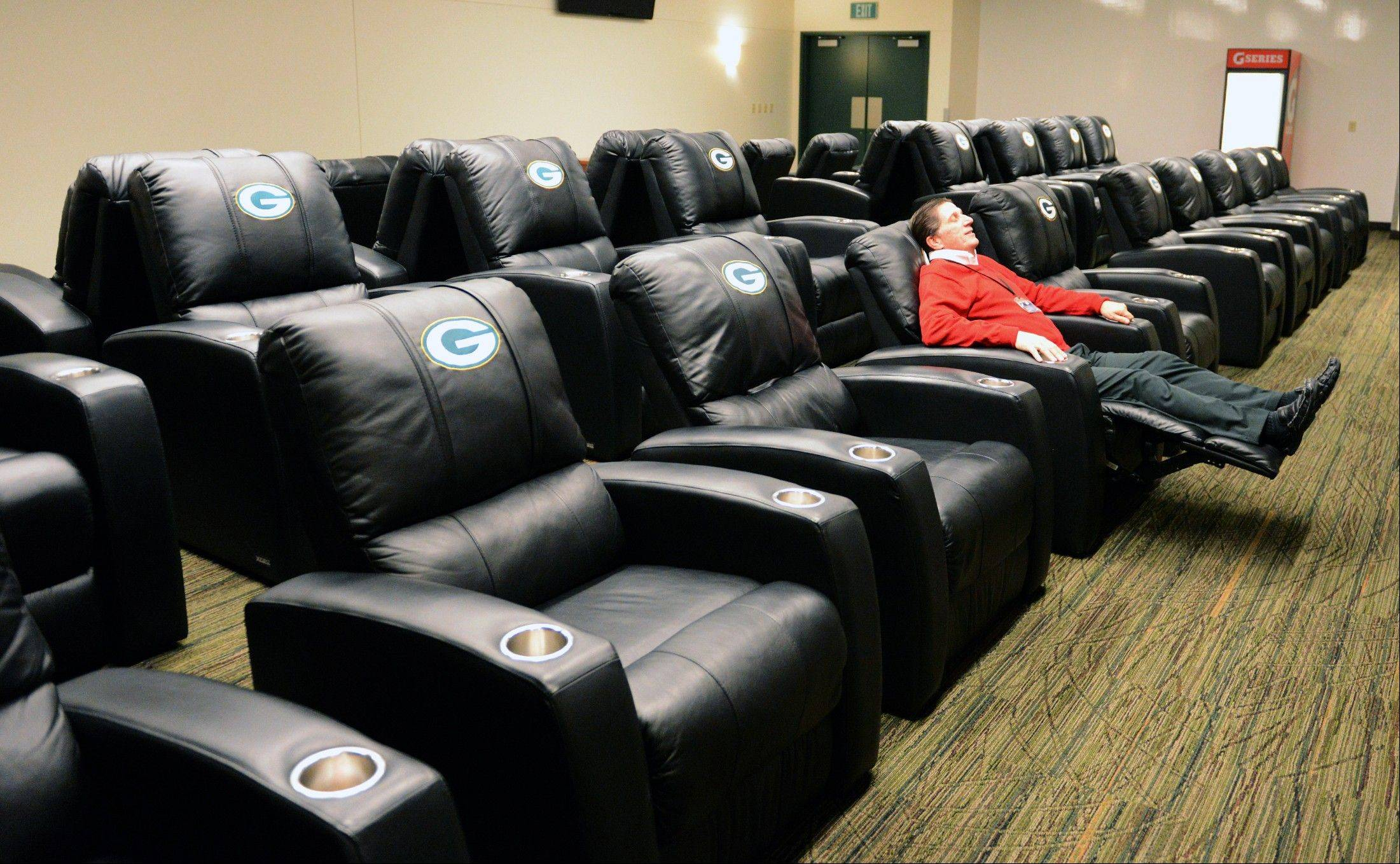 Stadium Board Consultant Greg Kuehl Tries Out The New Chairs In The Players  Lounge During A