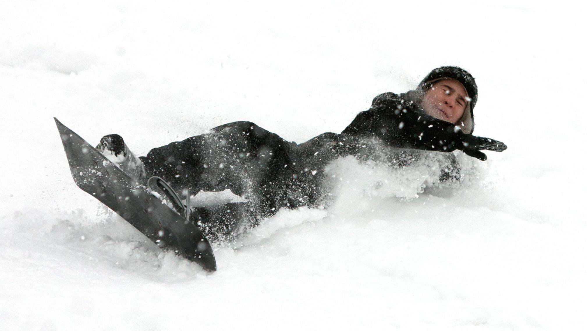 Luke Hogan, of Western Springs, enjoys snowboarding down a hill next to the Oak Brook Public Library.
