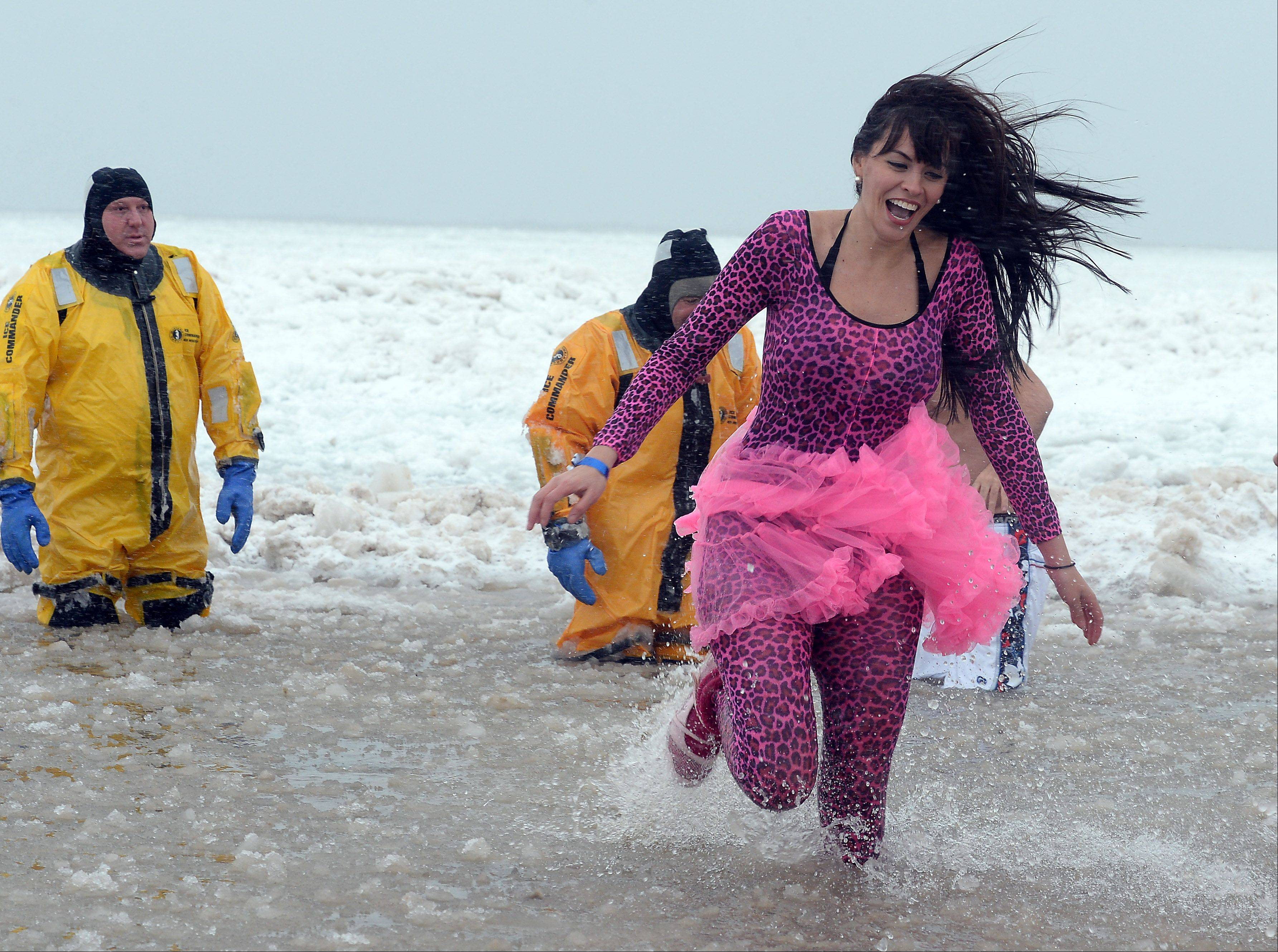 Anel Garza, of Waukegan, dons her tutu costume as she makes a quick run through the freezing water celebrating the new year during the 15th Annual Polar Bear Plunge at Waukegan Municipal Beach.