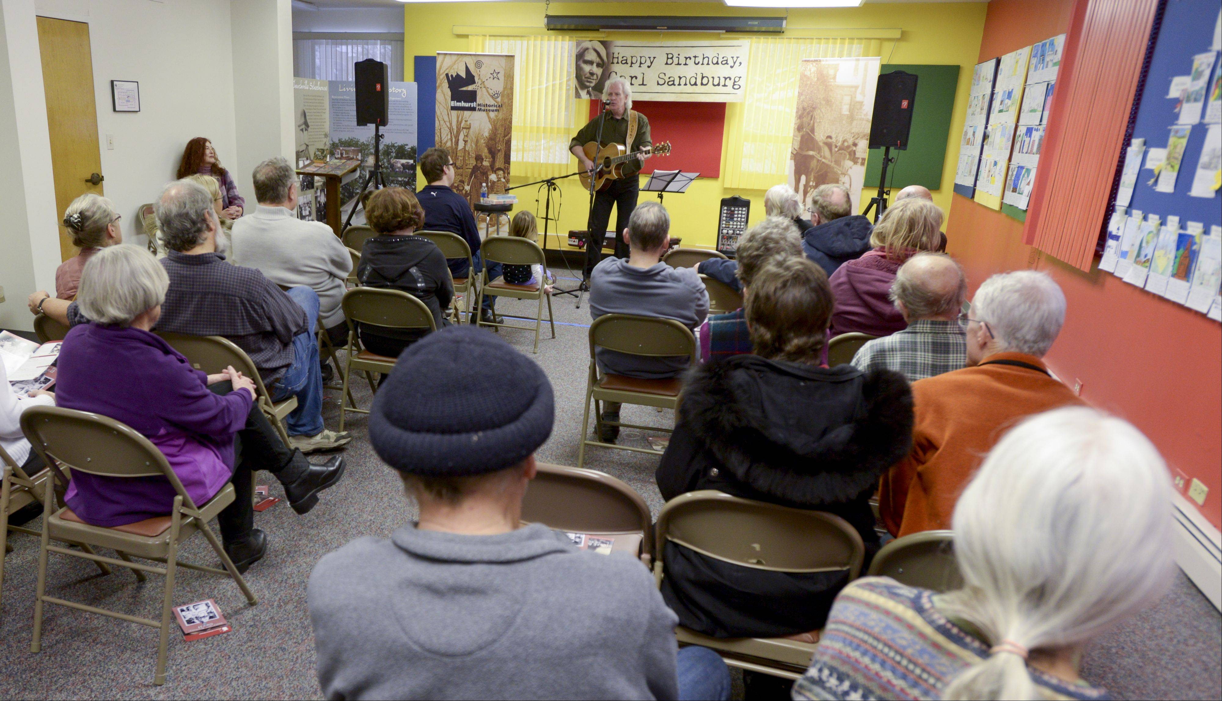 Folk singer Bucky Halker performs Sunday during the Elmhurst Historical Museum's celebration what would have been Carl Sandburg's 136th birthday. The birthday celebration coincided with the museum's exhibit on Sandburg that runs through April 20.