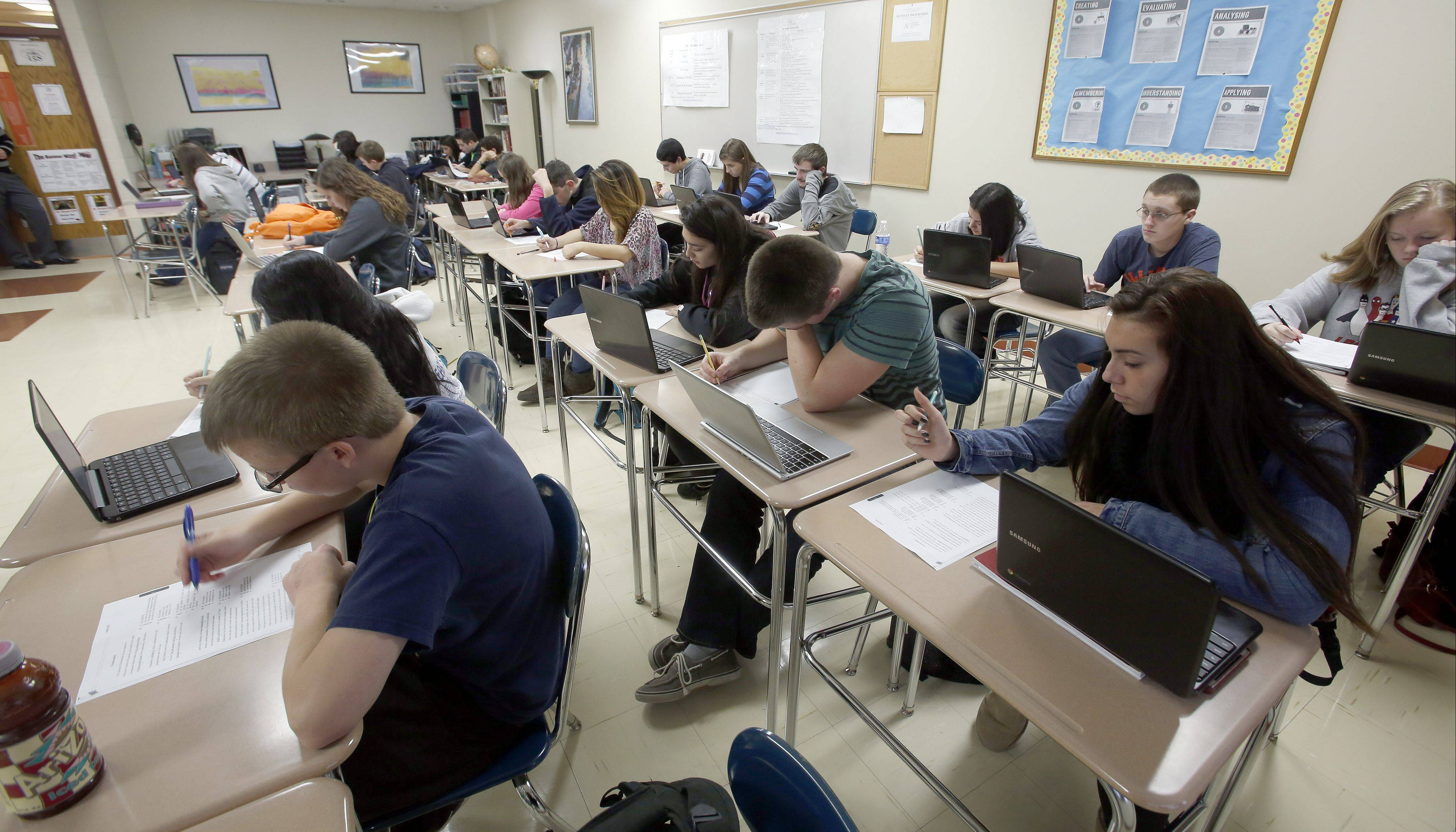 Students use Chromebooks during an English class at Huntley High School. The school's ACT composite score of 22.4 was the third highest in McHenry County in 2013 and nearly 67 percent of students tested were college ready.