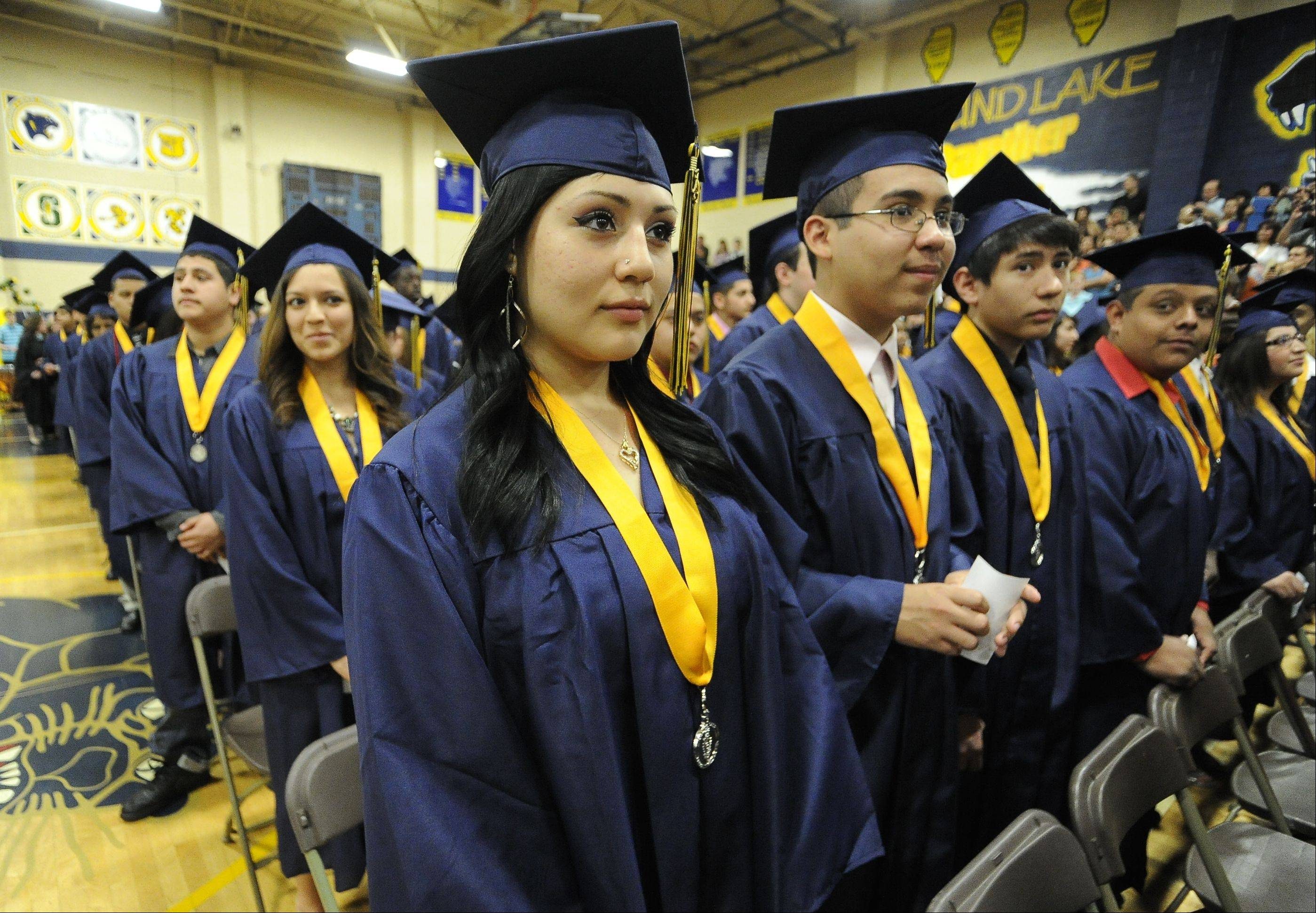 This is graduation day last May at Round Lake Senior High School, which has one of the lowest composite ACT scores of suburban schools. Officials are trying new strategies to improve test scores, including getting students to think about college in middle school.