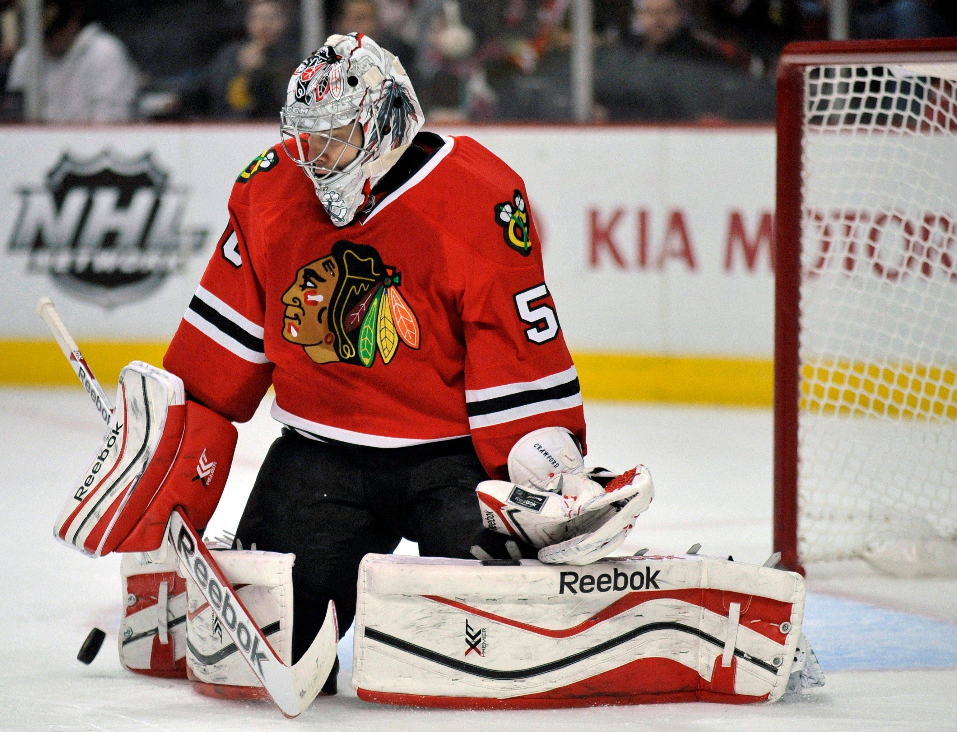 Chicago Blackhawks goalie Corey Crawford makes a save during the first period of an NHL hockey game Sunday against the San Jose Sharks in Chicago