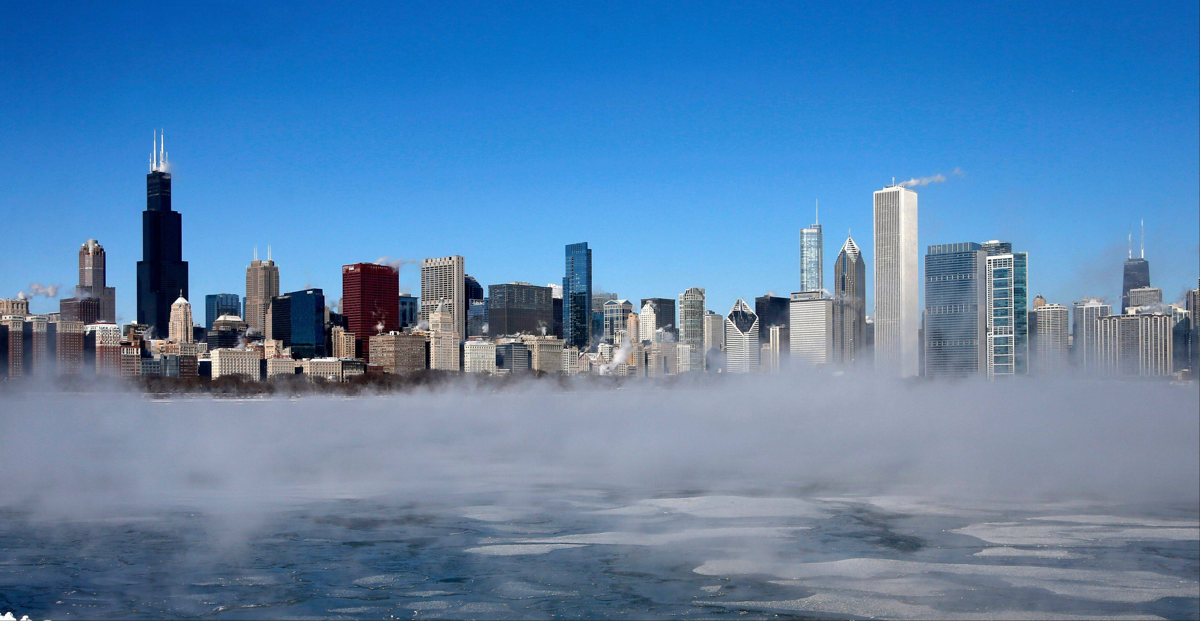 The Chicago skyline sits as a backdrop as fog drifts across Monroe Harbor with temperatures well below zero and wind chills down to 40 to 50 below Monday in Chicago. A whirlpool of frigid, dense air known as a �polar vortex� descended Monday into much of the U.S.