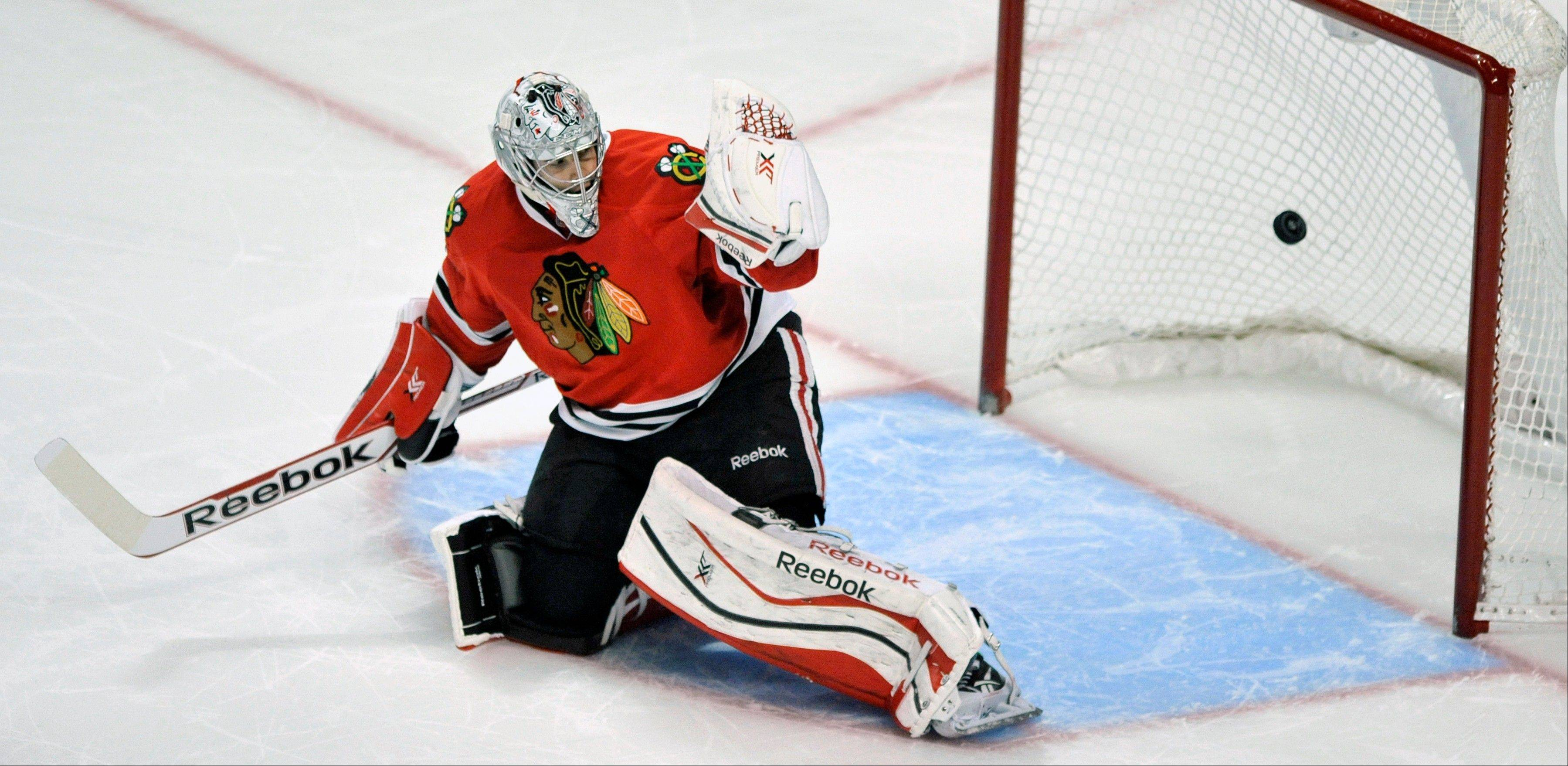 Blackhawks goalie Corey Crawford misses the winning goal scored by San Jose Sharks' Joe Pavelski during a shootout Sunday in an NHL hockey game in Chicago. San Jose won 3-2.