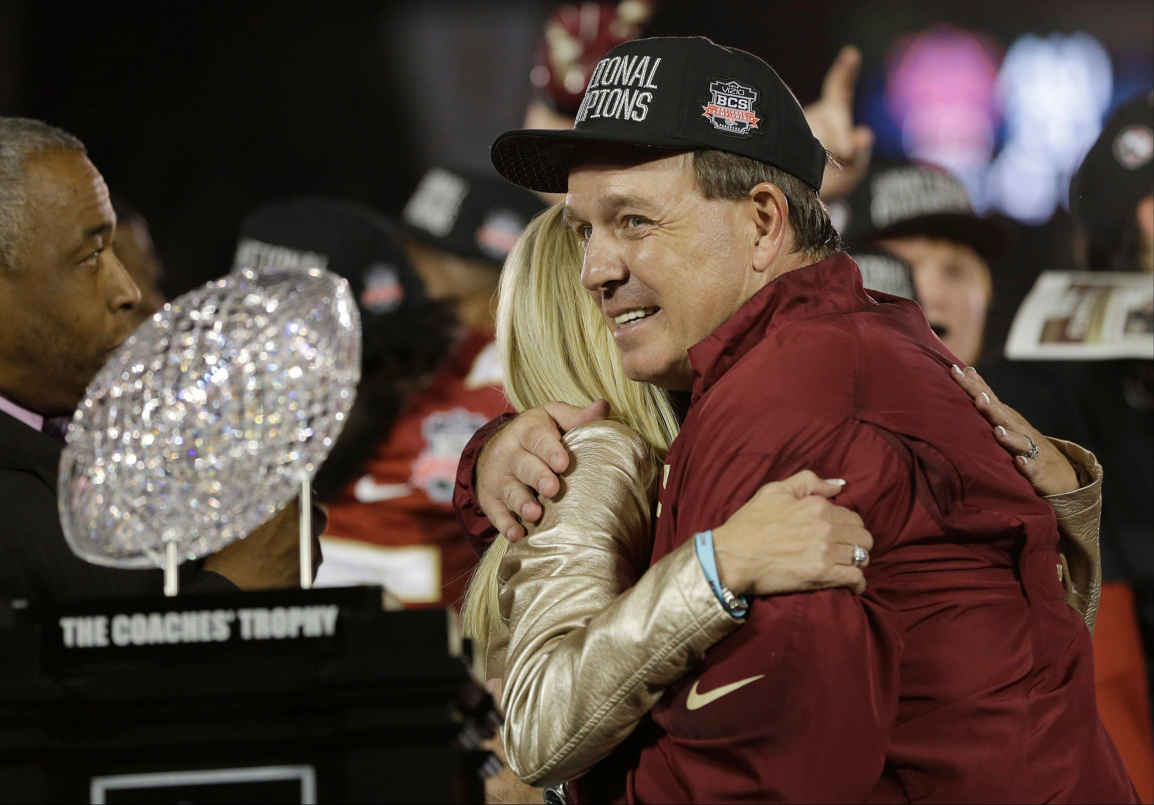 Florida State head coach Jimbo Fisher gets a hug after the NCAA BCS National Championship college football game against Auburn Monday, Jan. 6, 2014, in Pasadena, Calif. Florida State won 34-31.