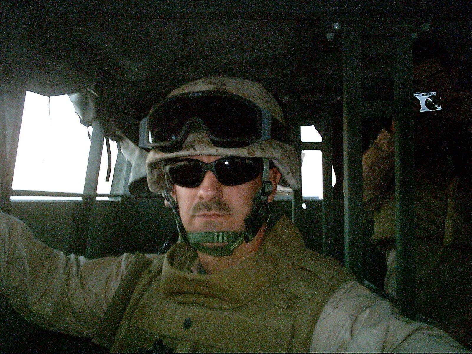 COURTESY OF ADVOCATE GOOD SAMARITAN HOSPITALDr. James Cole Jr. travels in a 7-ton truck on a convoy somewhere in Al Anbar Province, Iraq in 2007.
