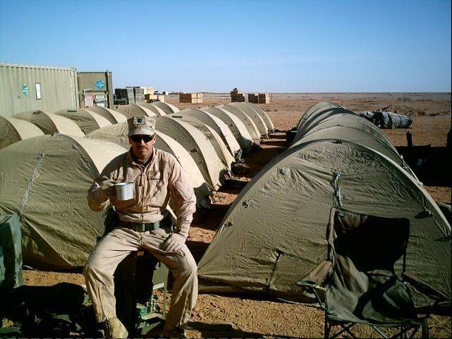COURTESY OF ADVOCATE GOOD SAMARITAN HOSPITALDr. James Cole Jr. is drinking out of the canteen cup holder while serving in Iraq in 2007.