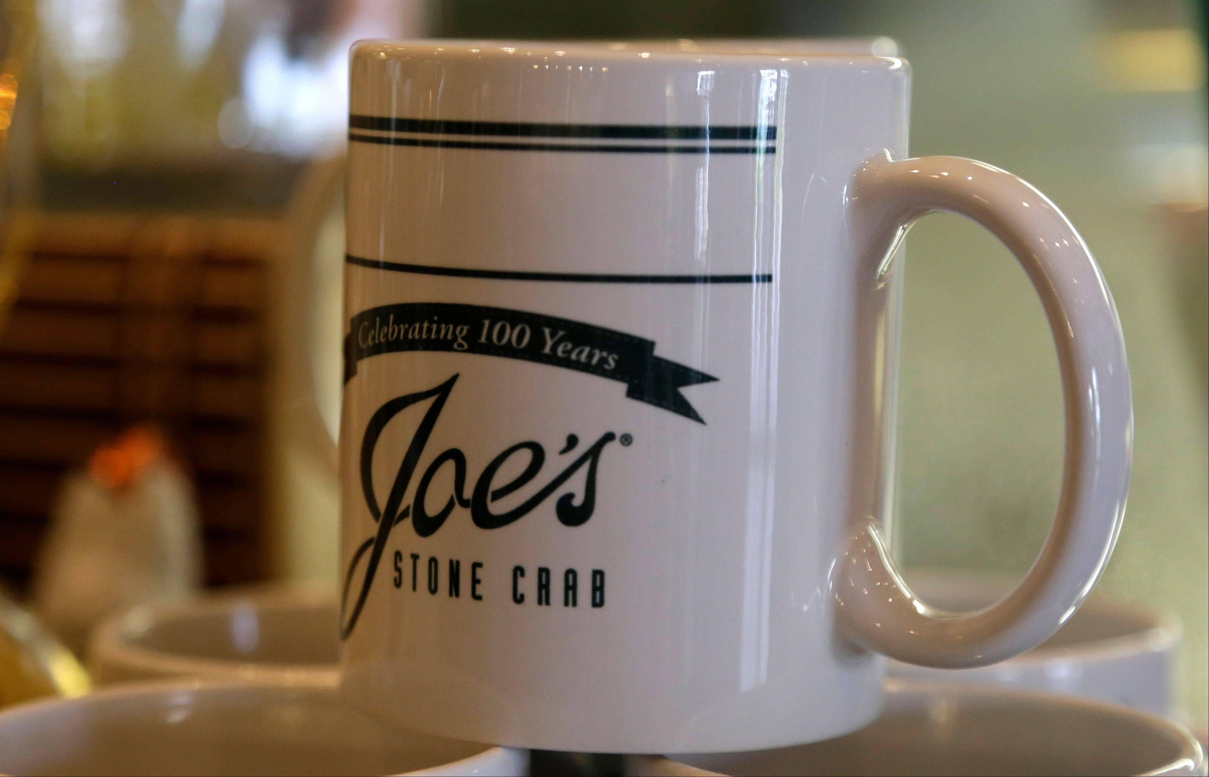 A coffee mug is among the mementos guests can pick up in the gift shop at Joe's Stone Crab restaurant in Miami Beach, Fla. Joe's Stone Crab has been family-owned from the start when it opened in 1913 as a mom-and-pop fish house.