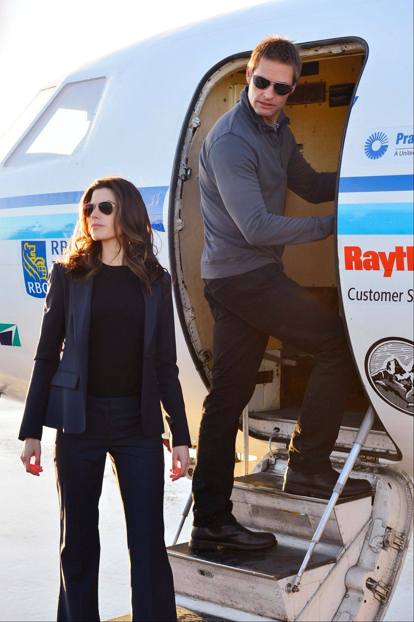 "Secret Service Agent Riley Neal (Meghan Ory) protects former special forces operative Gabriel Vaughn (Josh Holloway) in CBS' new drama ""Intelligence."""