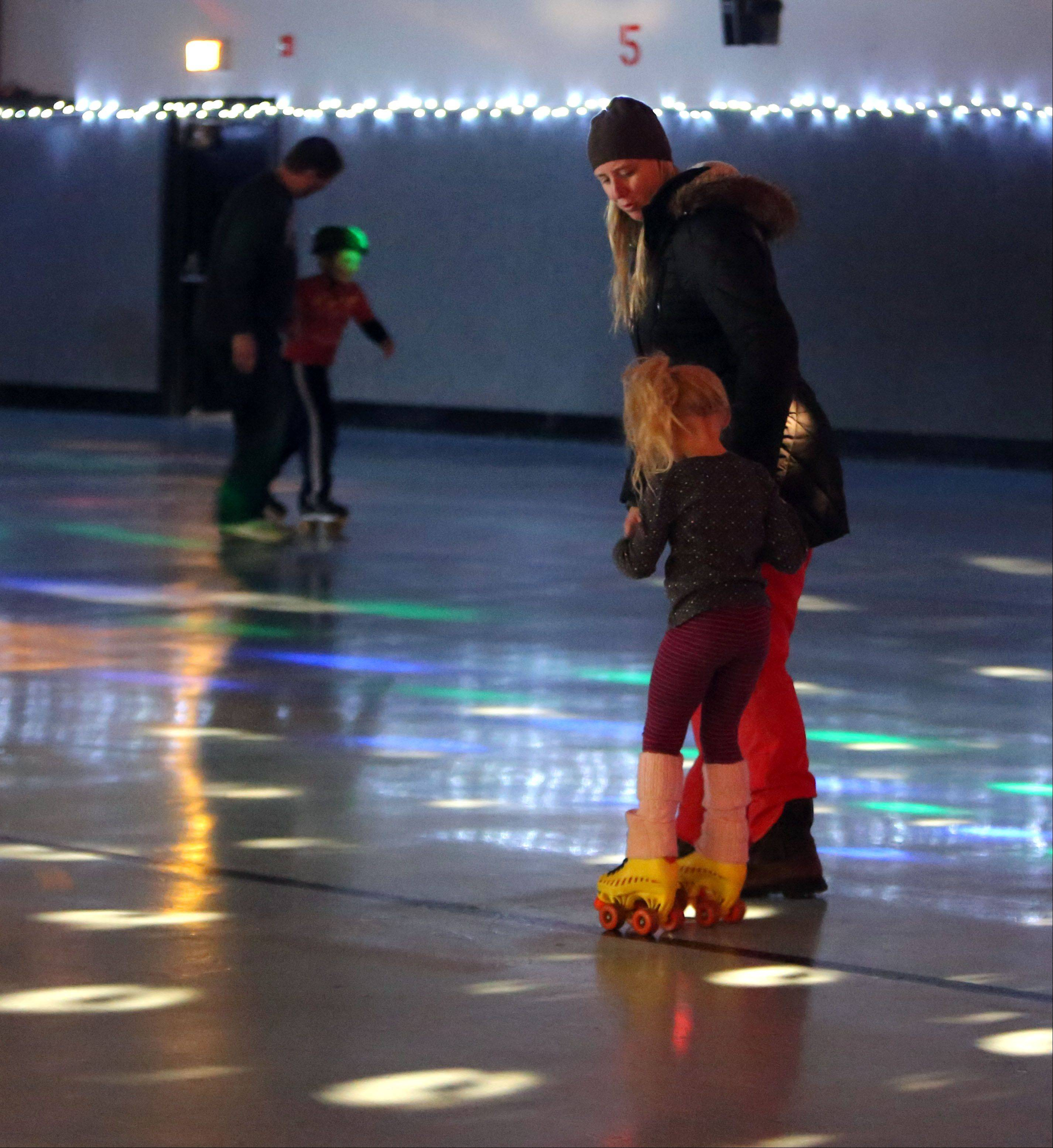 Jen Kallieris and her 5-year-old daughter, Dorothy, roller skate Monday inside Just for Fun Roller Rink in Mundelein.
