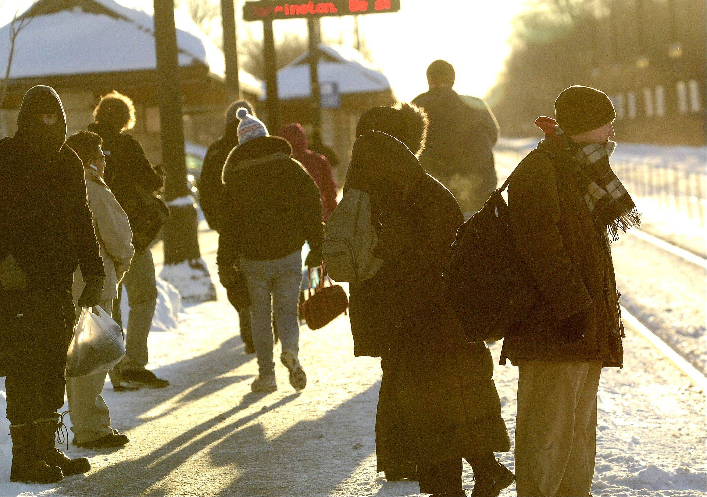 Cold commuters wait outside the Barrington Metra Station in -15 degree temperatures, waiting for the next train into Chicago Monday morning.