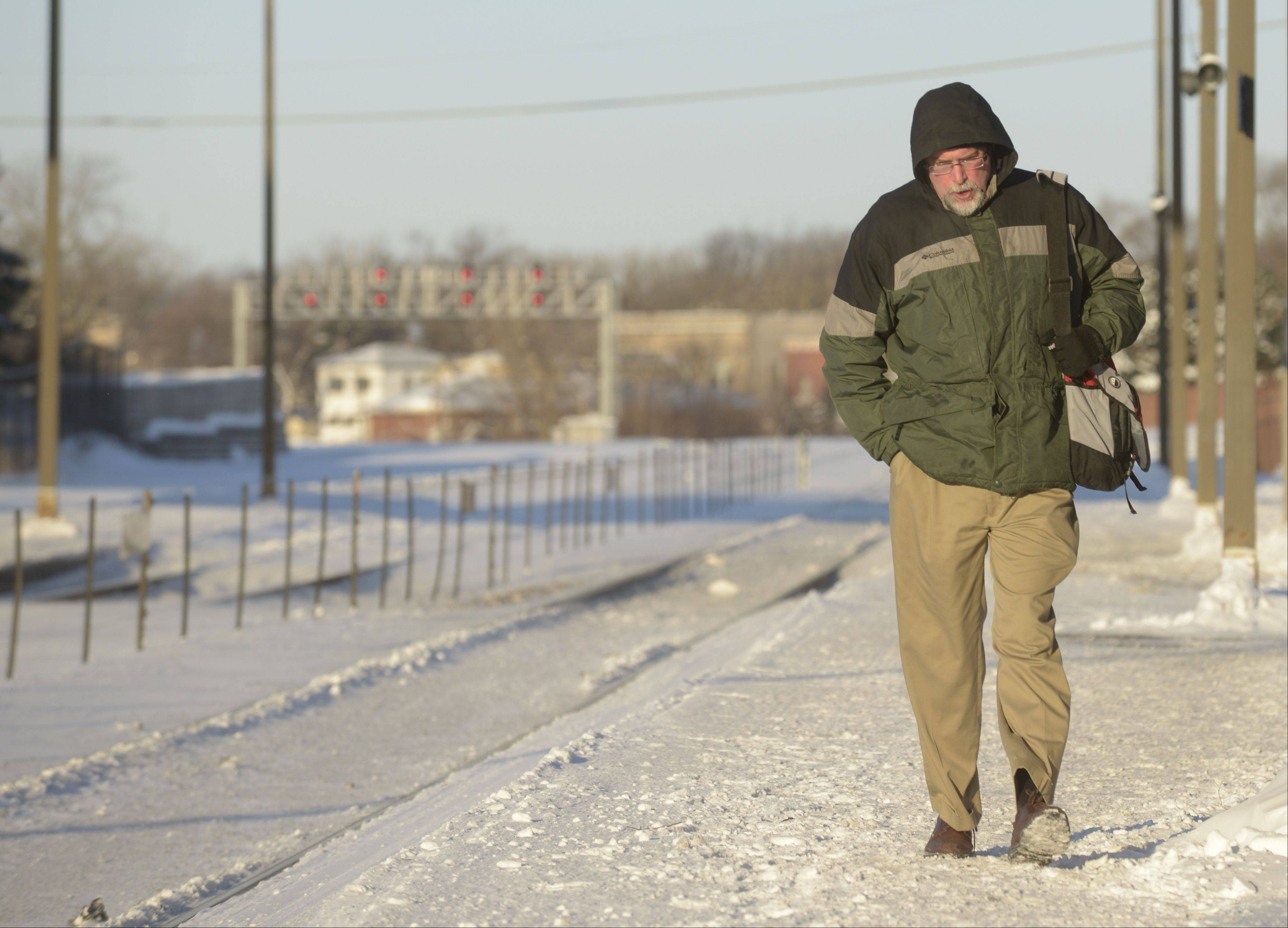Jim Beifuss of West Chicago hustles to the West Chicago train station only to find out his 8:25 a.m. train was canceled due to the extreme cold.