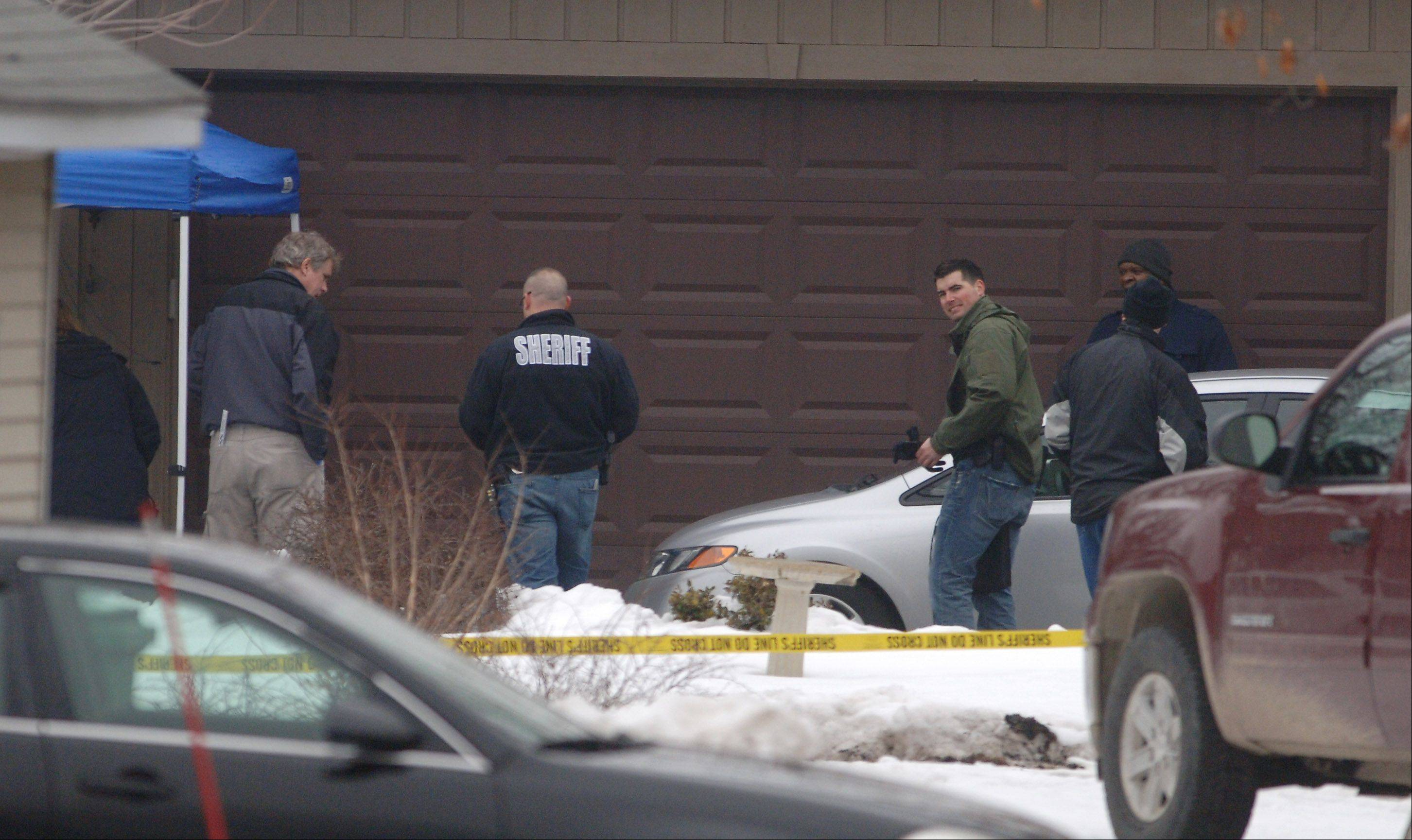 Police officials investigate the murder of Diane VanDycke-Kephart, 61, near Antioch in March.