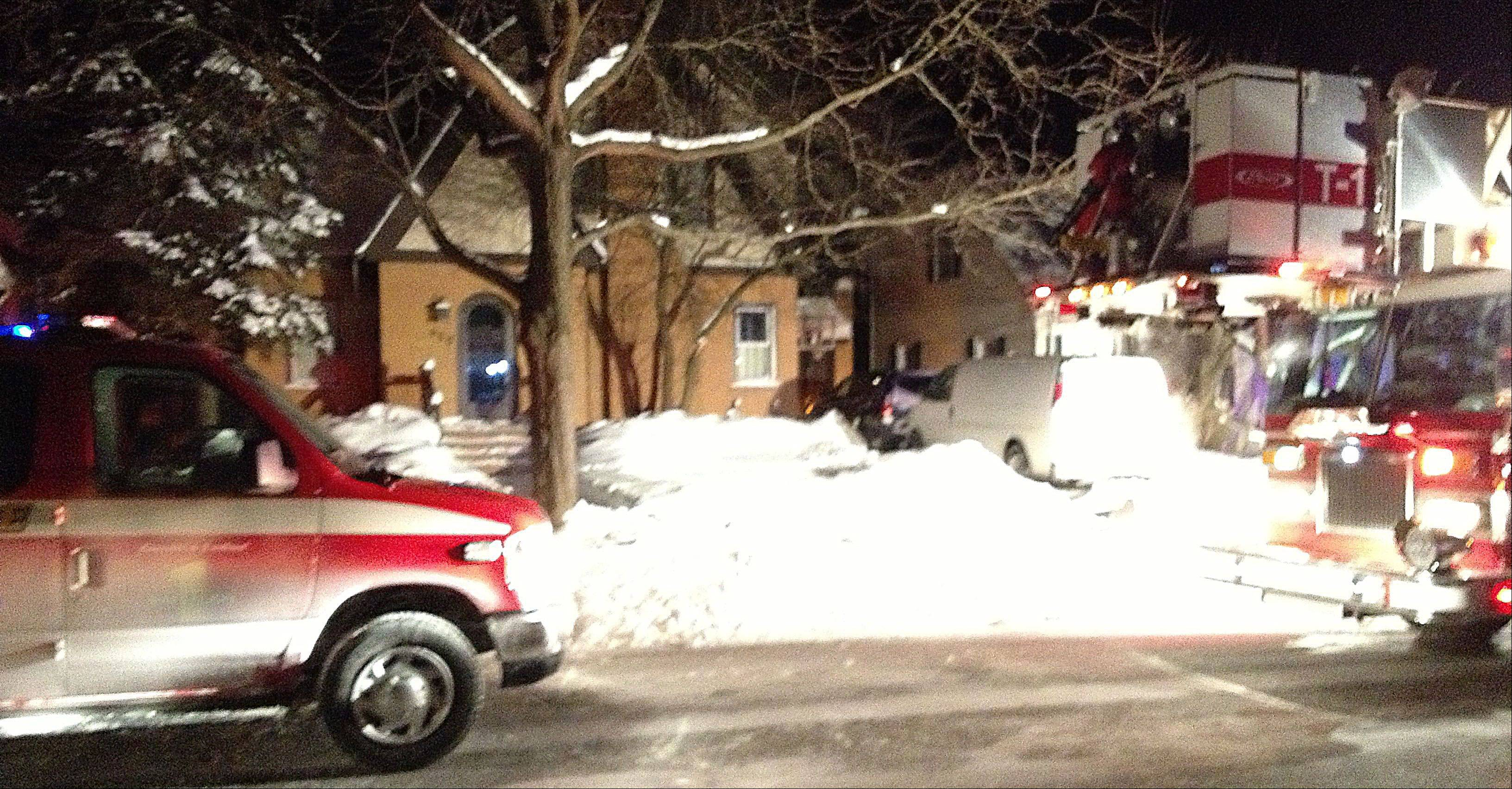 Rescue personnel respond a house fire Tuesday evening on the 400 block of South Dunton in Arlington Heights.