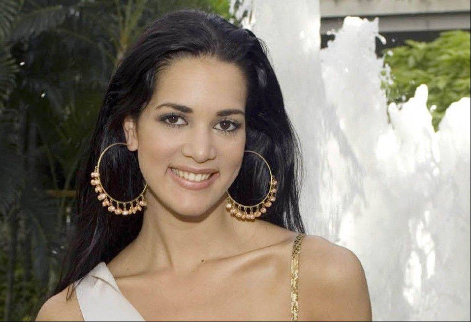 CORRECTS YEAR OF KILLING - FILE - This May 23, 2005 file photo released by Miss Universe shows Monica Spear, Miss Venezuela 2005, posing for a portrait ahead of the Miss Universe competition in Bangkok, Thailand. Venezuelan authorities say the soap-opera actress and former Miss Venezuela and her husband were shot and killed resisting a robbery after their car broke down. Prosecutors said in a statement that Monica Spear and Henry Thomas Berry were slain late Monday, Jan. 6, 2014 near Puerto Cabello, Venezuela�s main port. (AP Photo/Miss Universe Darren Decker, File)