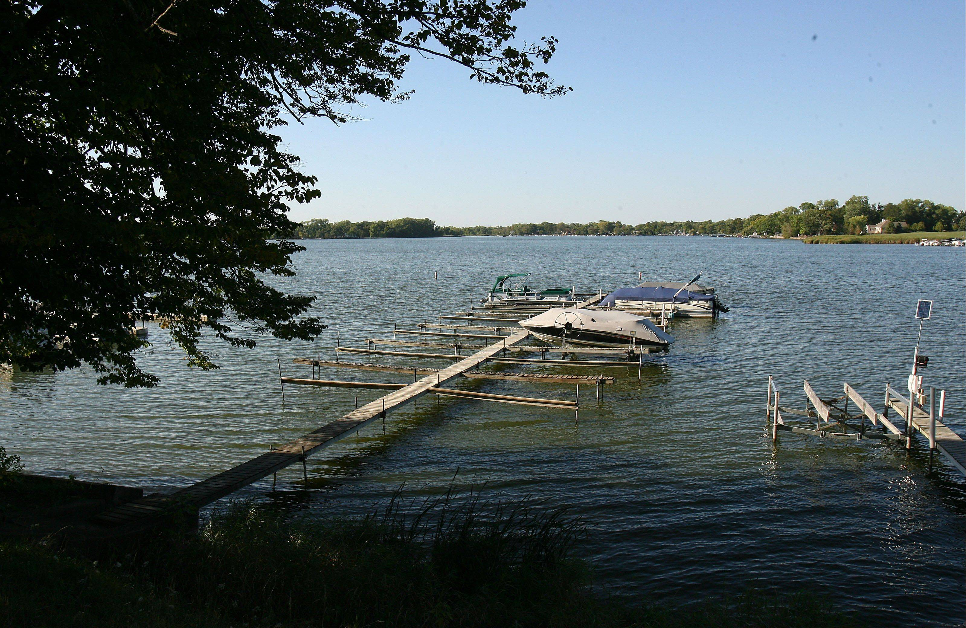 A few boats remain on the piers at Lake Marie Camp in Antioch before its closing in fall 2012. The Lake County Forest Preserve District owns the property and rights to 45 piers at the site, but is considering selling some of those rights, which could be worth $3,000 to $10,000 apiece.