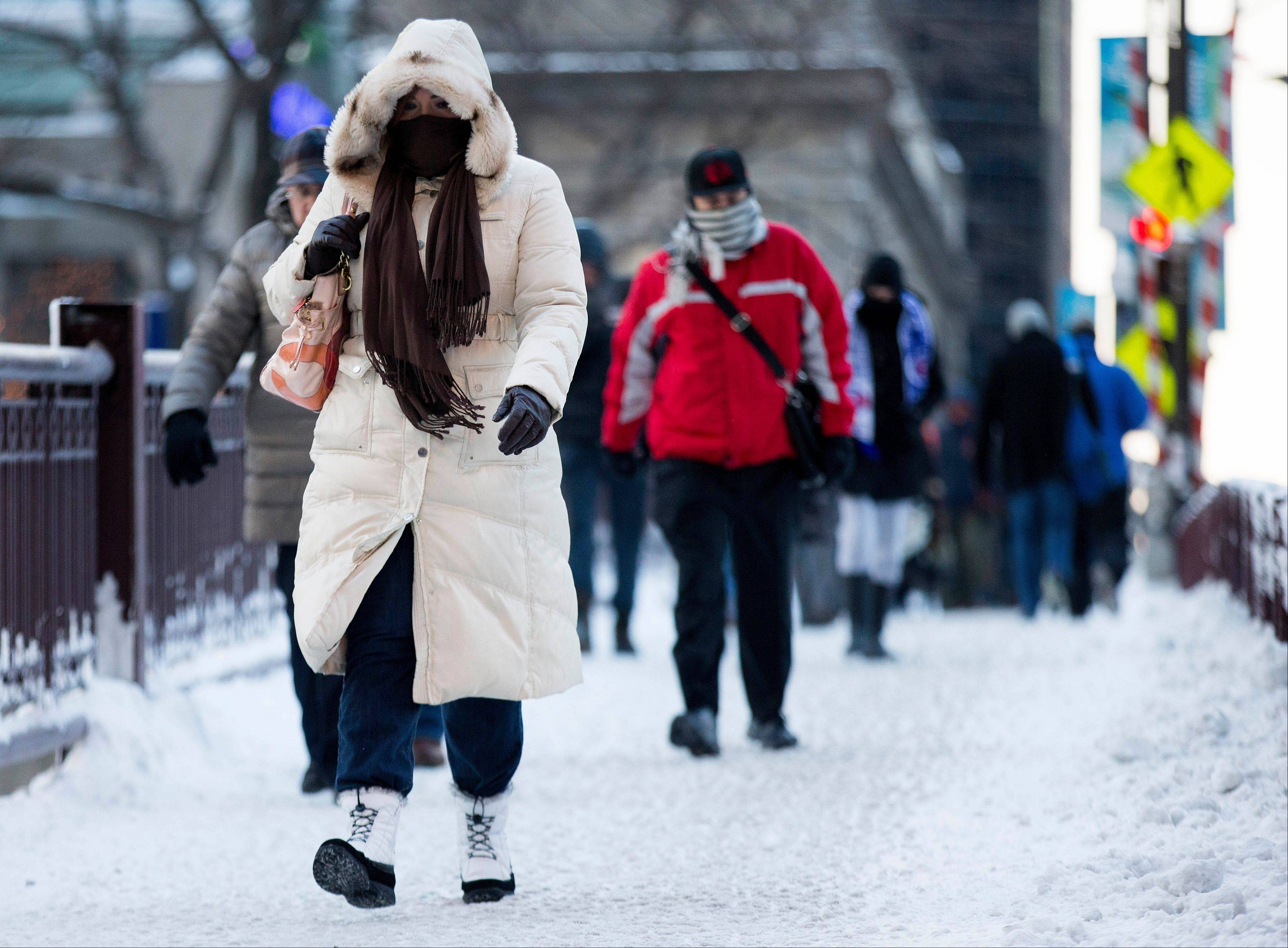 Commuters depart from Union Station with wind chills nearing minus 30 Fahrenheit on Tuesday, Jan. 7, 2014, in Chicago.