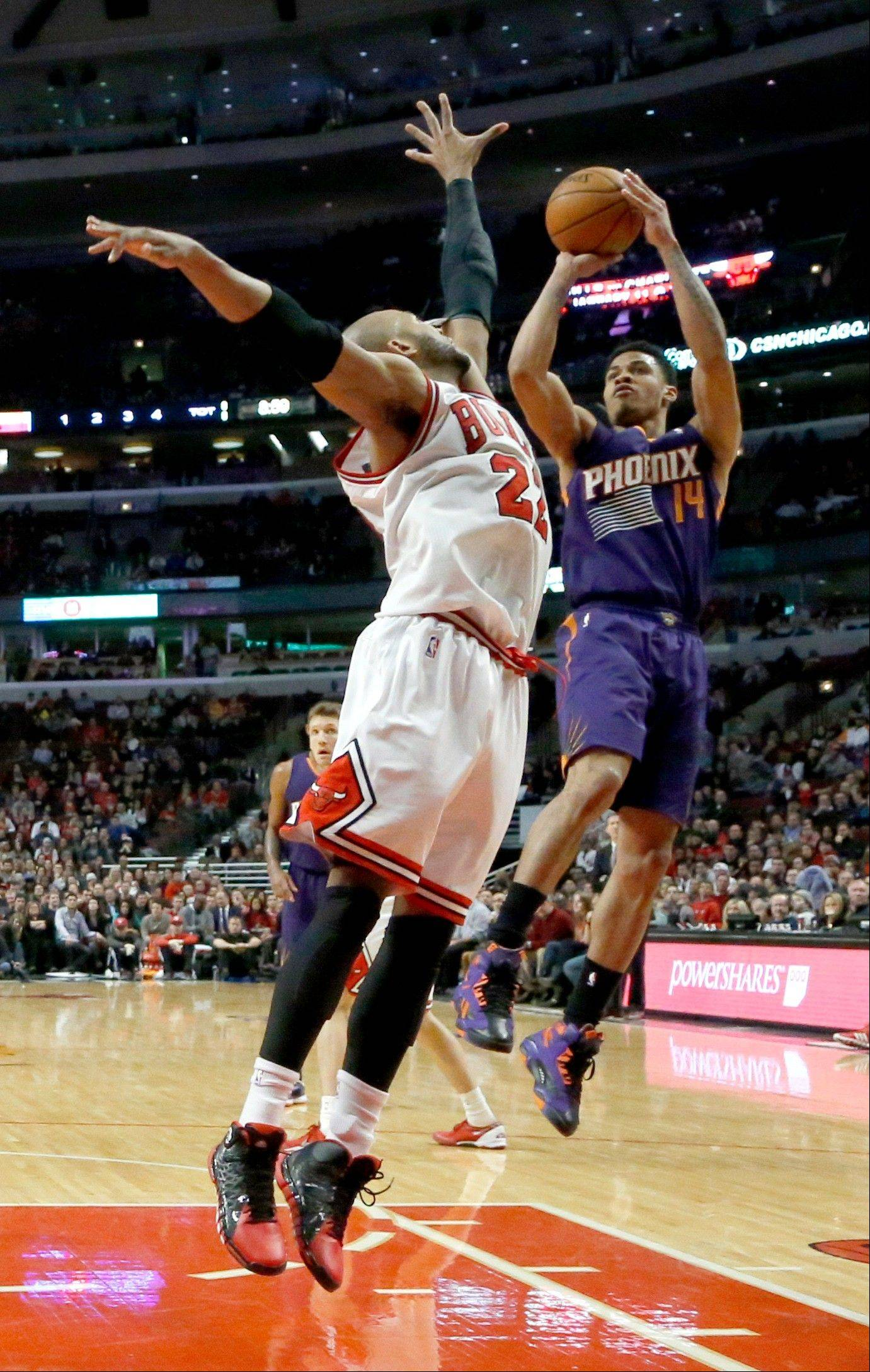 The Bulls� Taj Gibson goes up to defend a shot by the Suns� Gerald Green on Tuesday night at the United Center. The Bulls won 92-87.