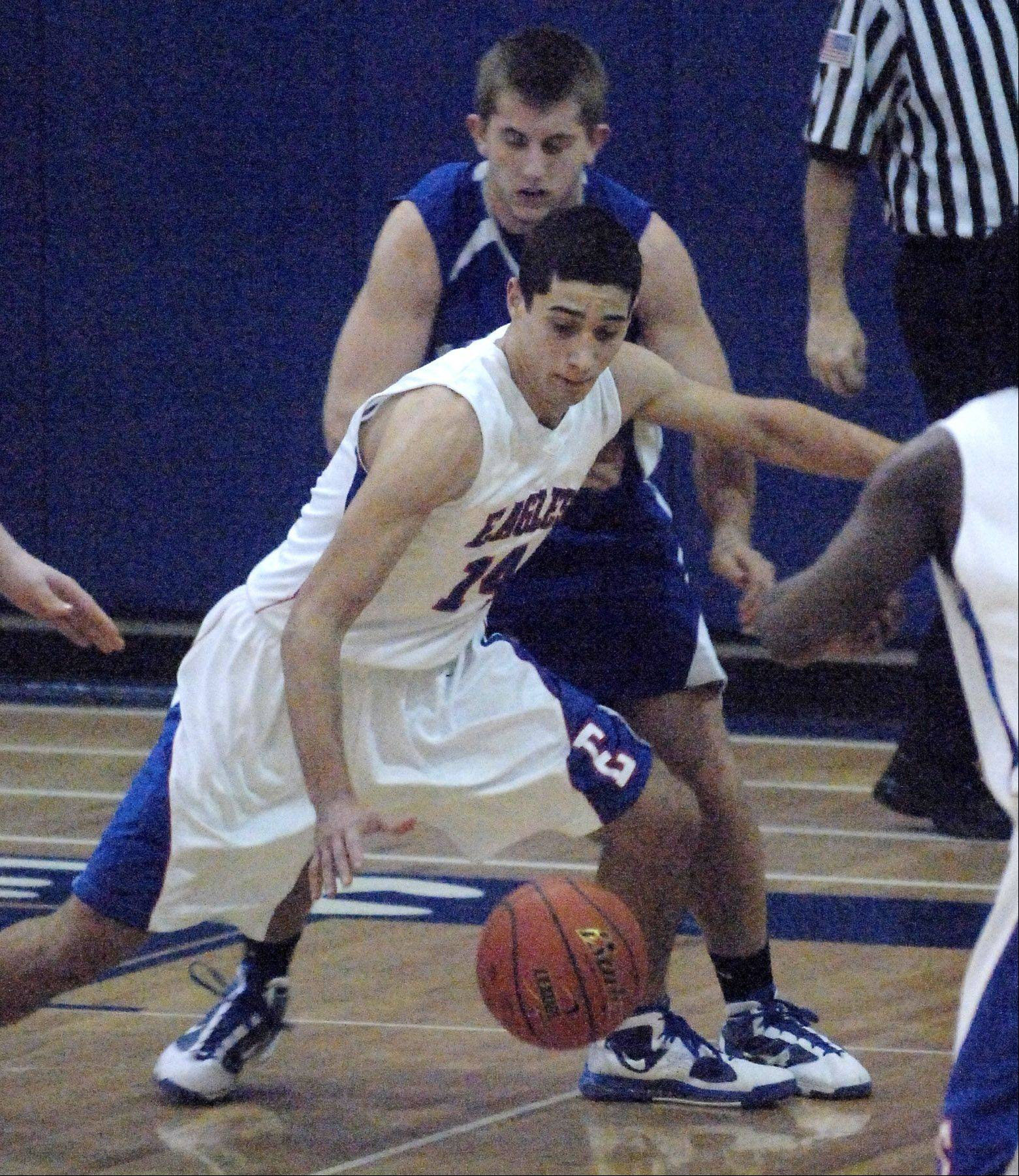 John Androus chases down a loose ball against Vernon Hills during his senior season at Lakes.