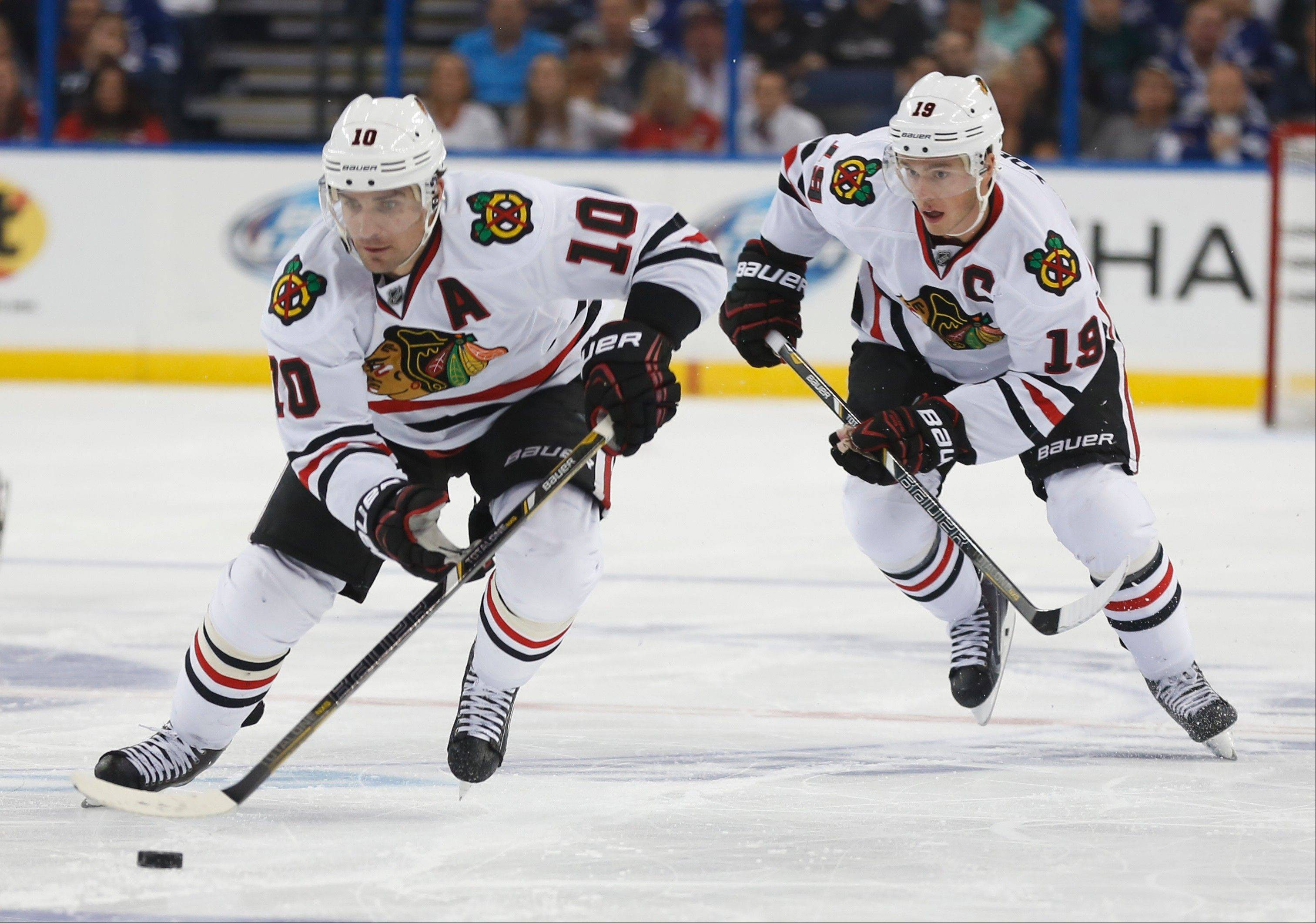 Teammates Patrick Sharp (10) and Jonathan Toews will play for Team Canada in next month�s Olympic Games in Sochi along with Blackhawks defenseman Duncan Keith. While Brent Seabrook and Corey Crawford didn�t make the Canada�s roster, a total of 10 Blackhawks will be heading to Sochi for Olympic duty.