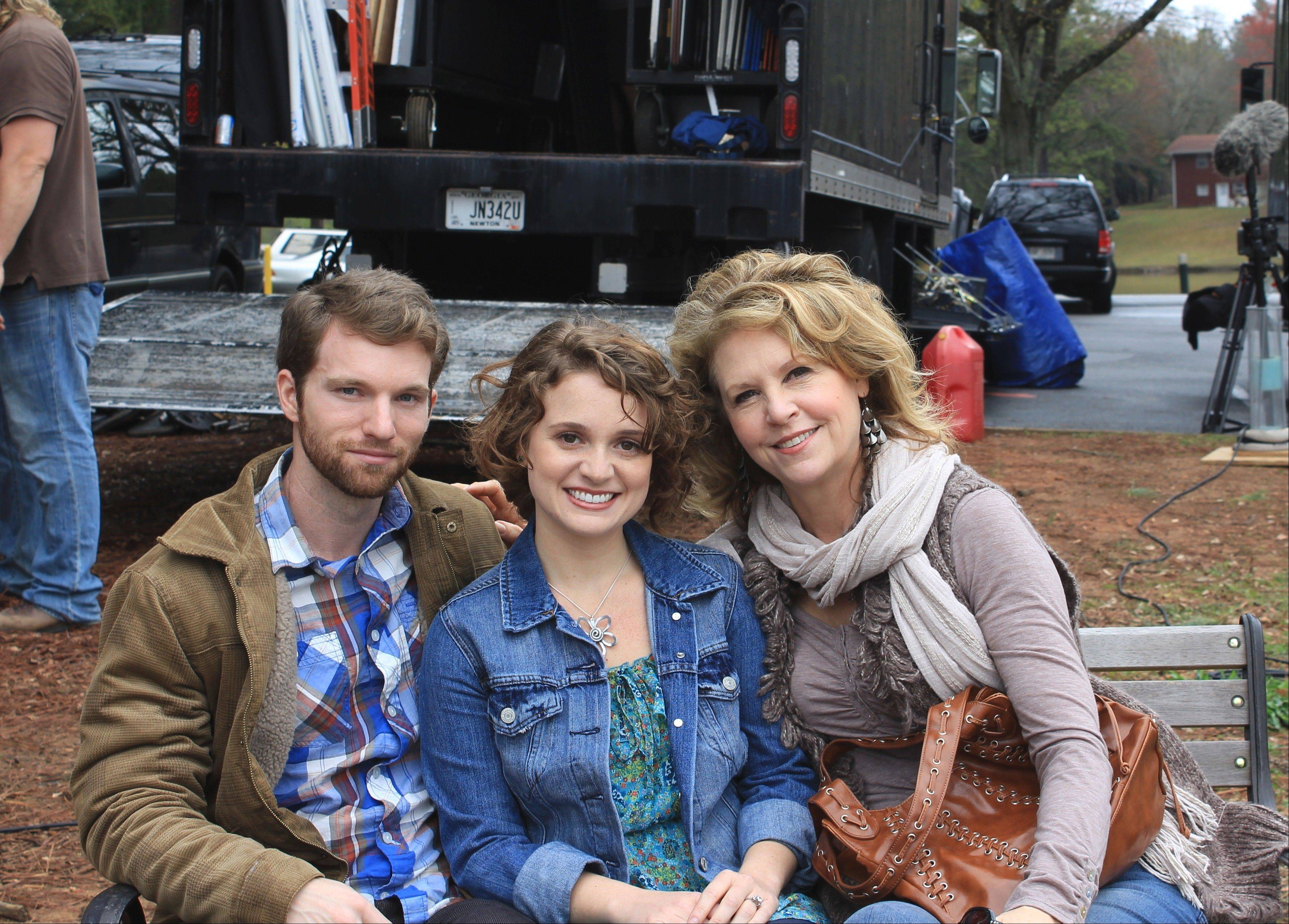 "Longtime suburbanite Francine Locke chats with actors Kelsi Chandler and Drew Matthews, who respectively play her daughter-in-law and son in the new movie ""Stand Your Ground."""