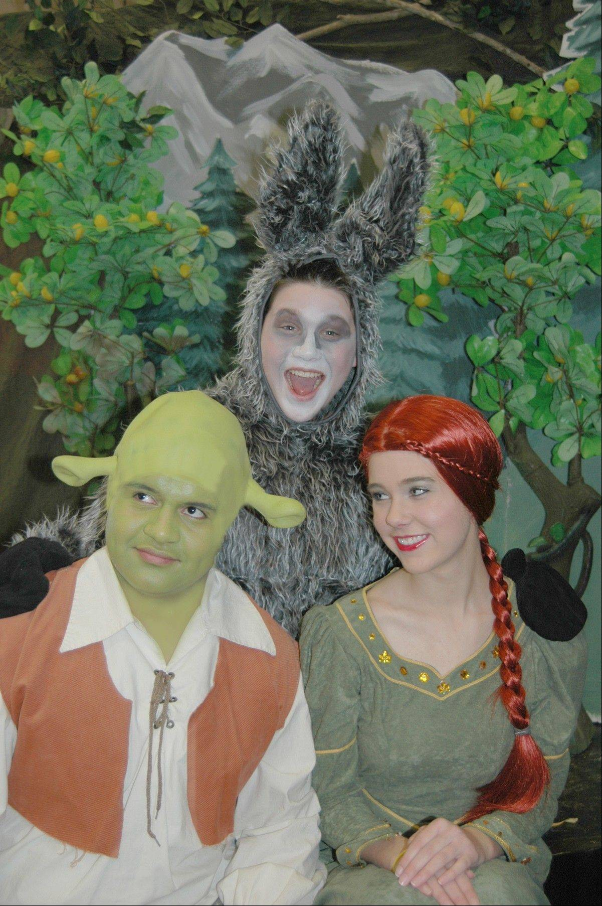 "From left, Fabian Guerrero as Shrek, Elisabeth Coster as Princess Fiona and Jake Ziman as Donkey perform the leading roles in ""Shrek the Musical,"" which hits the stage at the Prisco Community Center in Aurora this weekend for four shows."